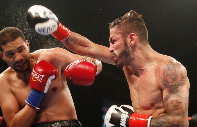 Jorge Linares, of Venezuela, attacks Abner Cotto of Puerto Rico during the main event of the Goldenboy Fight Night at Fantasy Springs Casino on September 29, 2018.