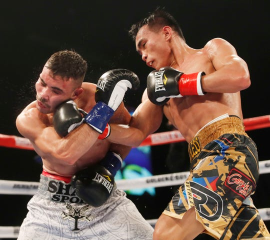 Romero Duno, of the Philippines, lands a right against Ezequiel Avilez of Mexico during their co-main event of the Goldenboy Fight Night at Fantasy Springs Casino on September 29, 2018.