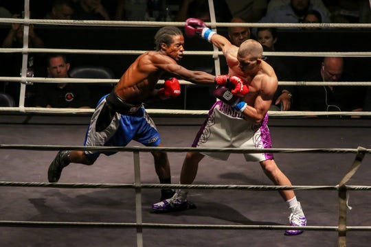 Devin Cushing, blue tape, takes on Calvin Smith during Island Fights 50 at the Pensacola Bay Center on Saturday, September 29, 2018. Cushing won by referee stoppage after the second round when Smith refused to answer the bell to start the third round and improved to 9-0.