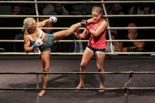Hannah Goldy, blue tape, takes on Shannon Goughary during Island Fights 50 at the Pensacola Bay Center on Saturday, September 29, 2018. Goldy won by unanimous decision.
