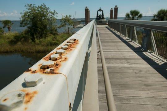 Rusting parts on the bridge of the Hawkshaw Lagoon Missing Children Memorial.