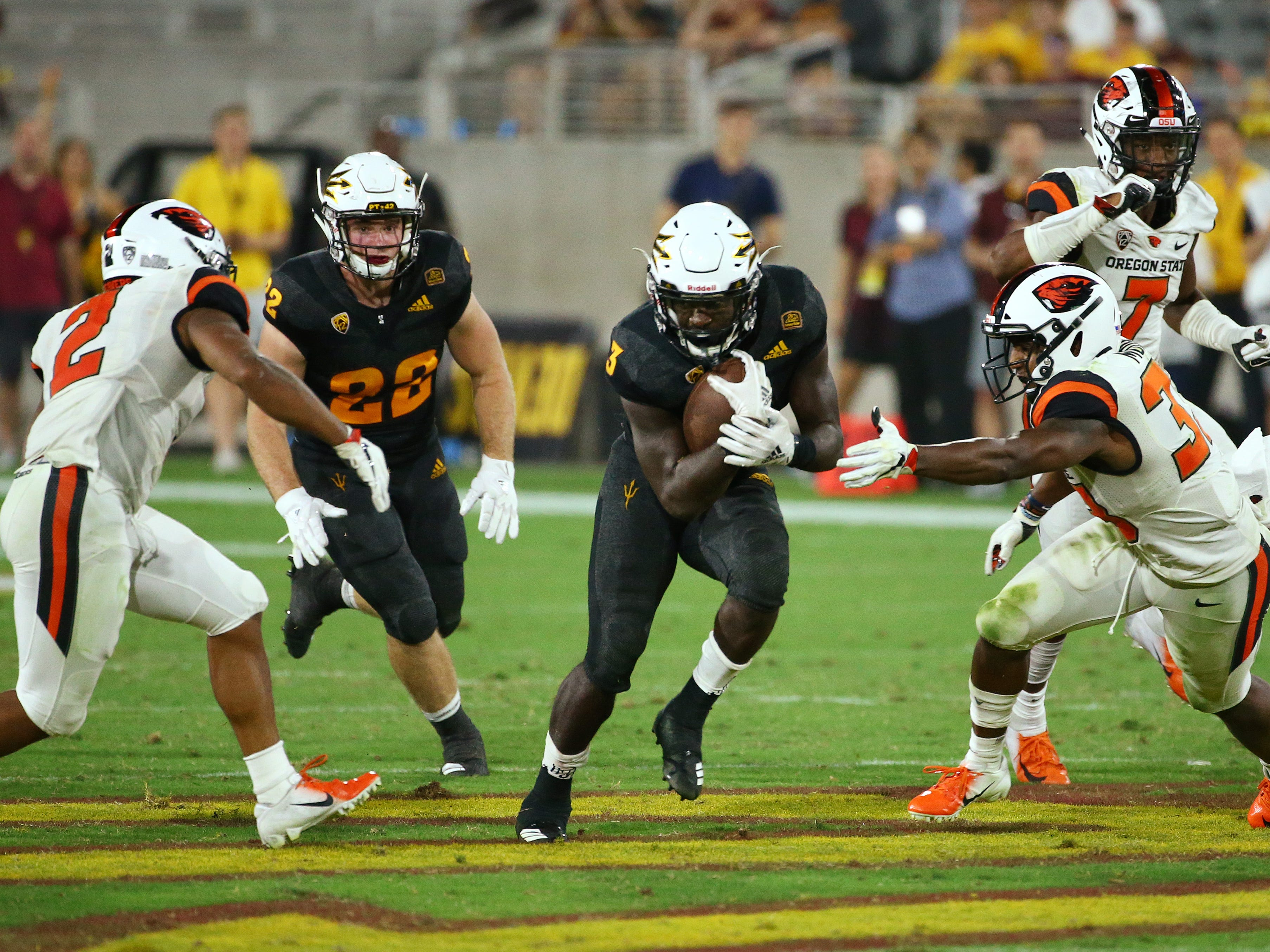 Arizona State running back Eno Benjamin on this play reached 312 yards for the game against Oregon State in the second half on Sep. 29, 2018, at Sun Devil Stadium.