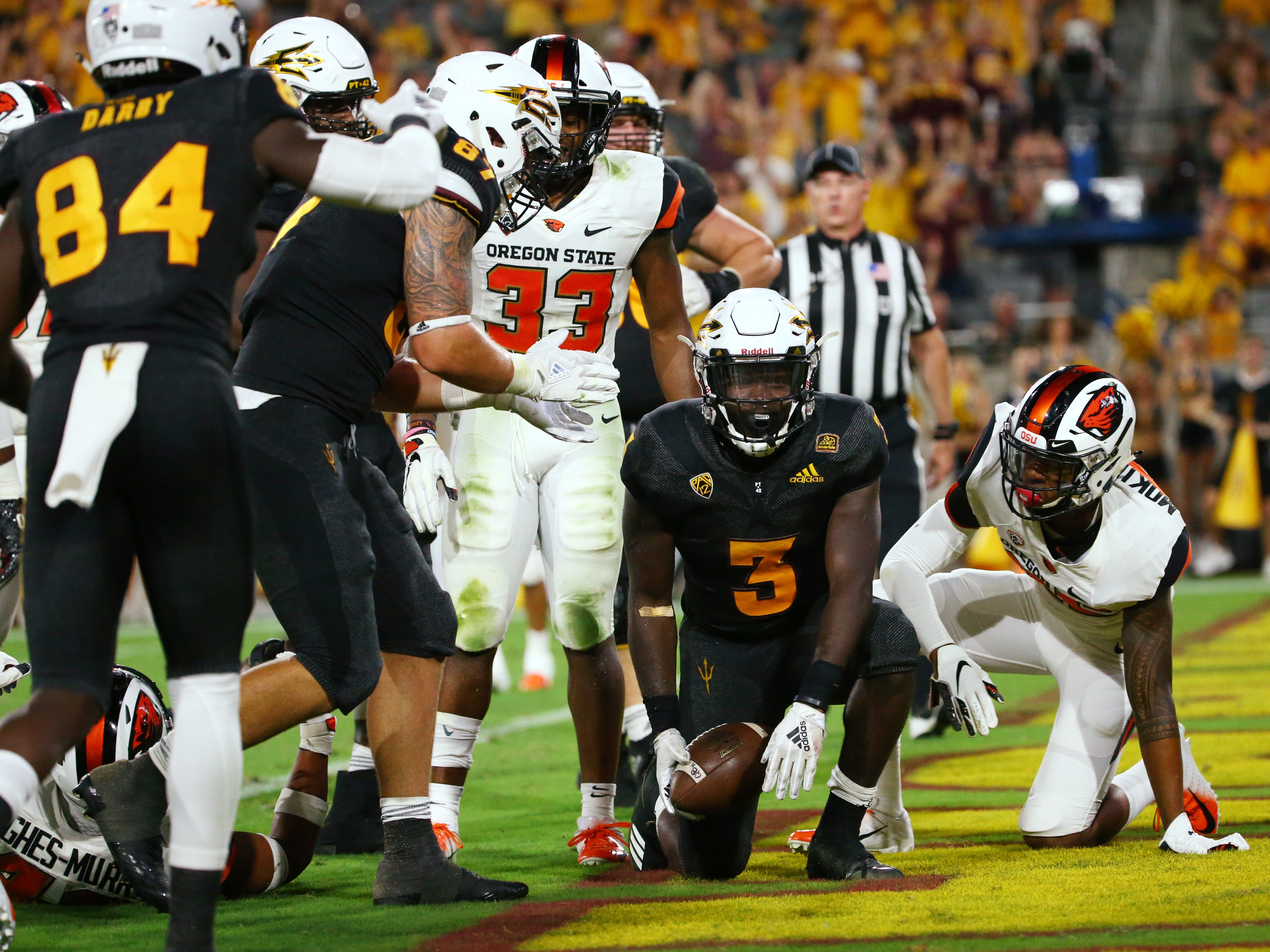 Arizona State running back Eno Benjamin scores a touchdown against Oregon State in the second half on Sep. 29, 2018, at Sun Devil Stadium.
