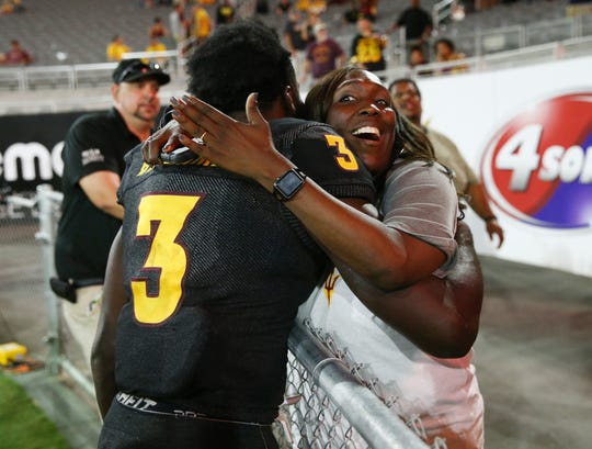 Arizona State running back Eno Benjamin receives a hug after his 312-yard rushing game against Oregon State on Sep. 29, 2018, at Sun Devil Stadium.