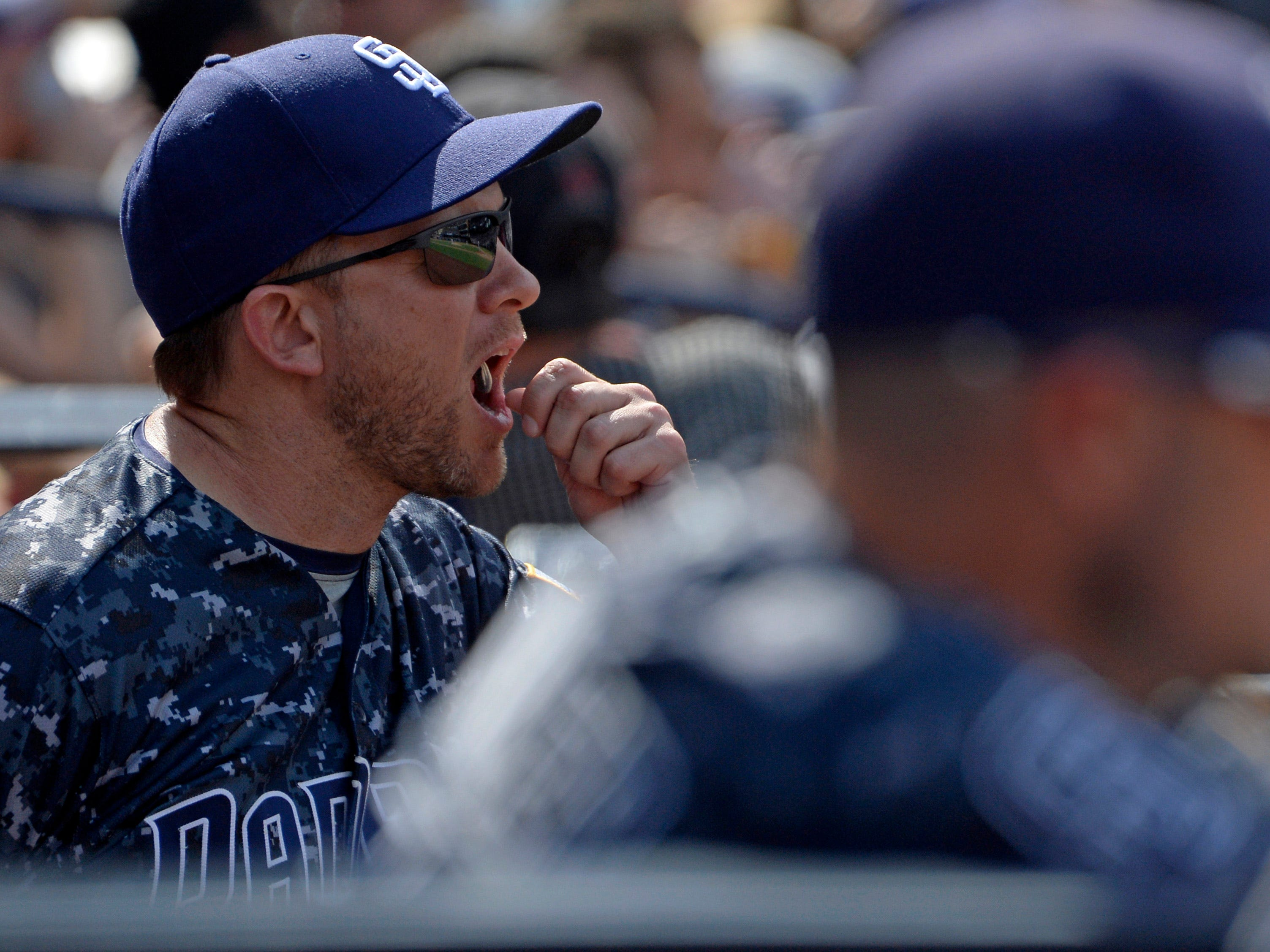 Sep 30, 2018; San Diego, CA, USA; San Diego Padres manager Andy Green (14) tosses sunflower seeds into his mouth in the sixth inning against the Arizona Diamondbacks at Petco Park. Mandatory Credit: Jake Roth-USA TODAY Sports