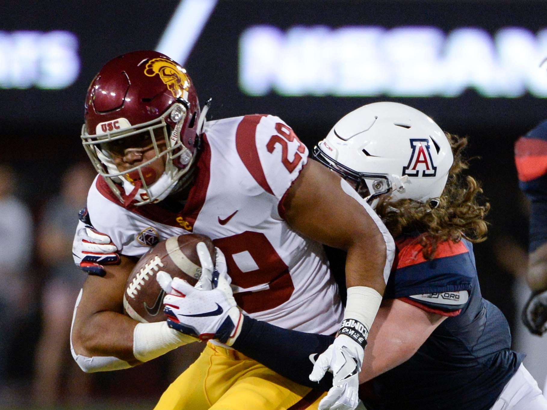 Sep 29, 2018; Tucson, AZ, USA; Southern California Trojans running back Vavae Malepeai (29) runs the ball as he is tackled by Arizona Wildcats linebacker Colin Schooler (7) during the first half at Arizona Stadium. Mandatory Credit: Casey Sapio-USA TODAY Sports