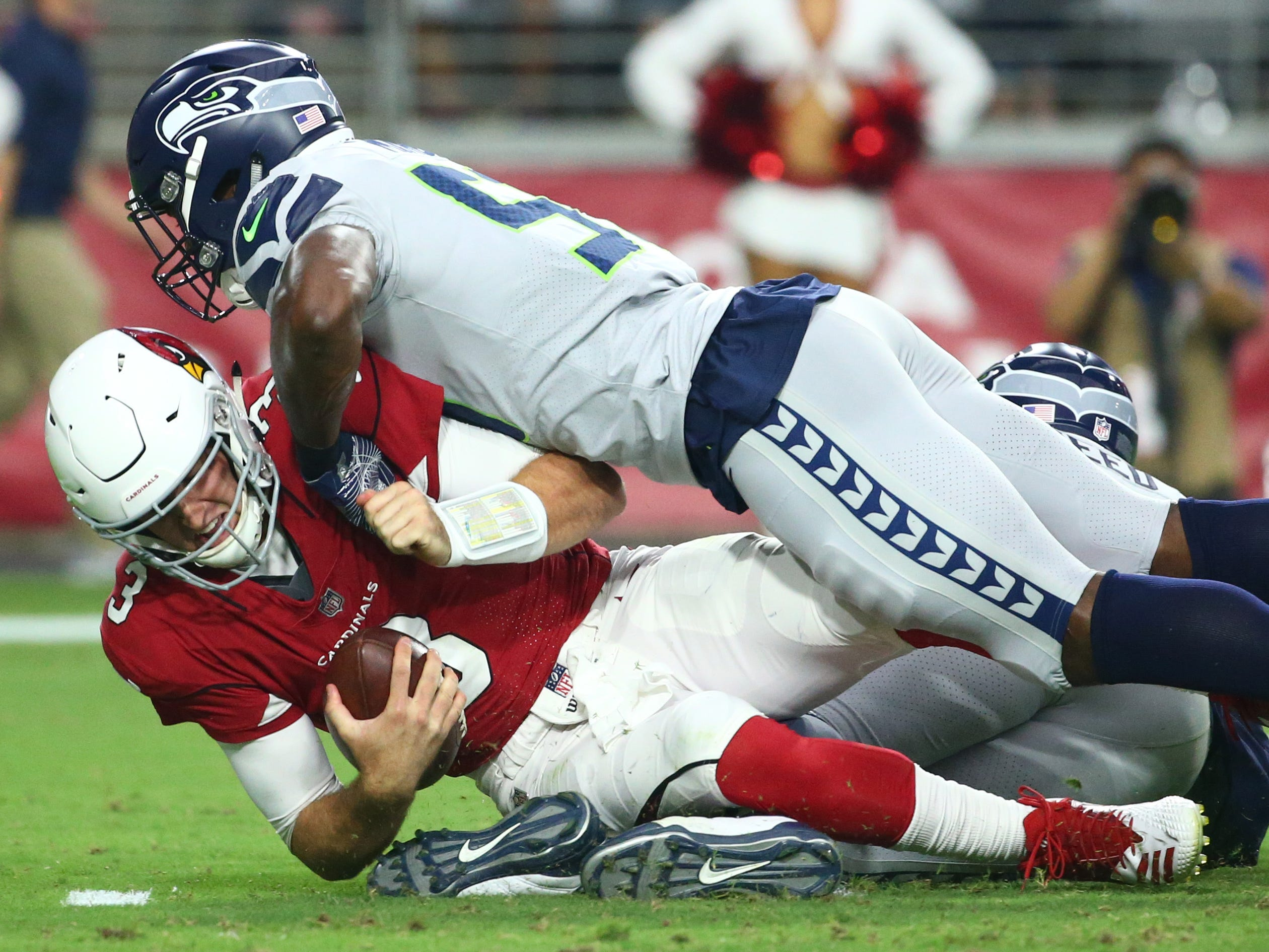 Arizona Cardinals quarterback Josh Rosen is sacked by Seattle Seahawks linebacker Barkevious Mingo in the first half at State Farm Stadium in Glendale, Ariz.