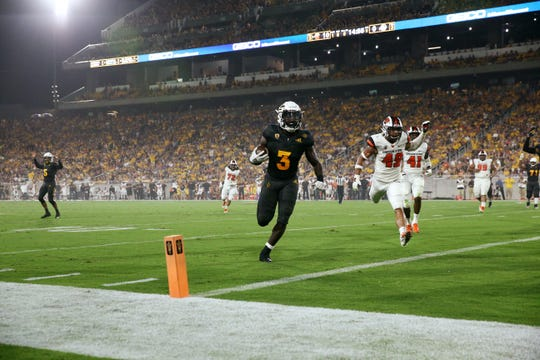 ASU running back Eno Benjamin scores a touchdown – one of four total – against Oregon State on Saturday.