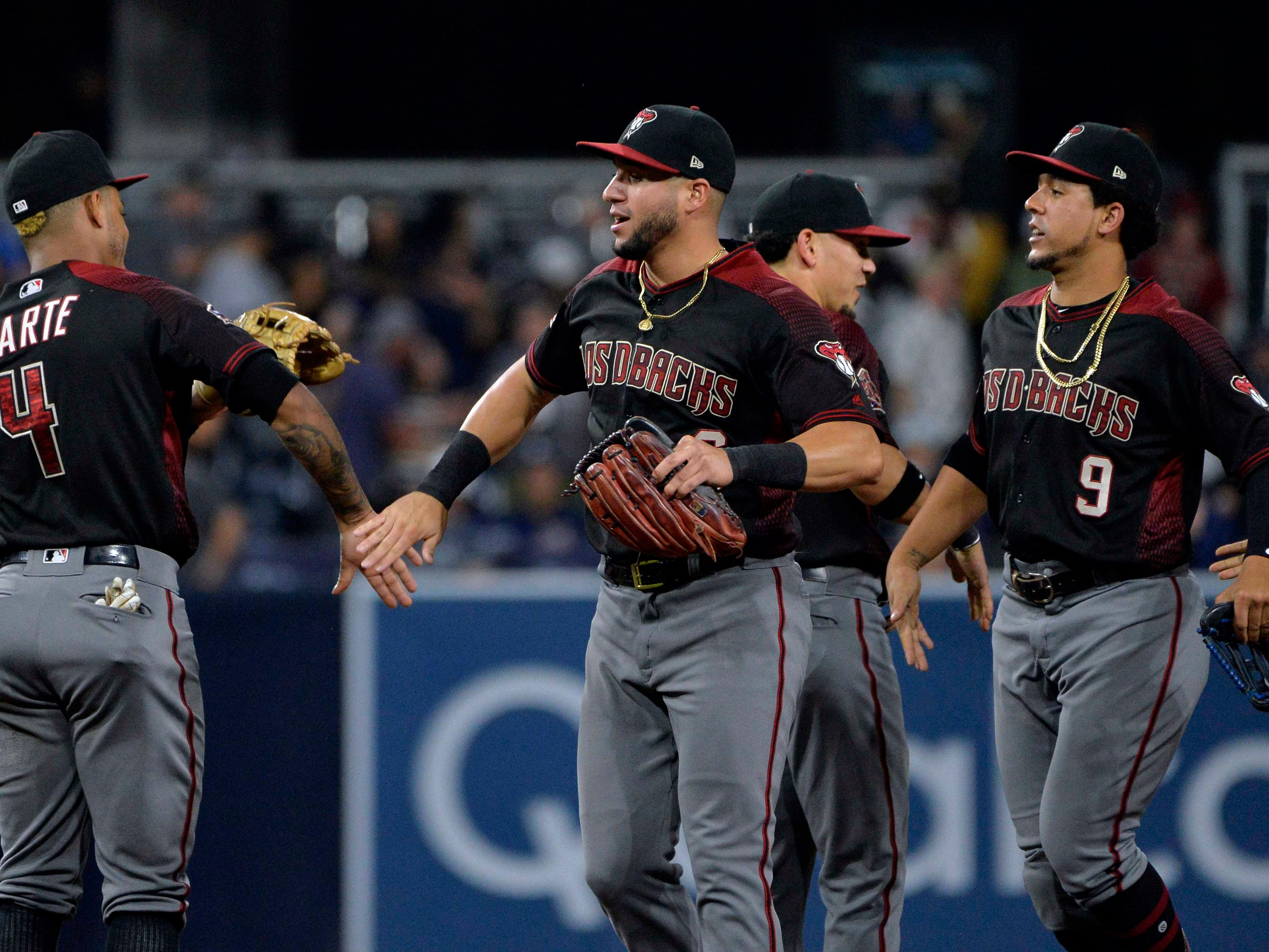 Sep 29, 2018; San Diego, CA, USA; The Arizona Diamondbacks celebrate a 5-4 win over the San Diego Padres at Petco Park. Mandatory Credit: Jake Roth-USA TODAY Sports