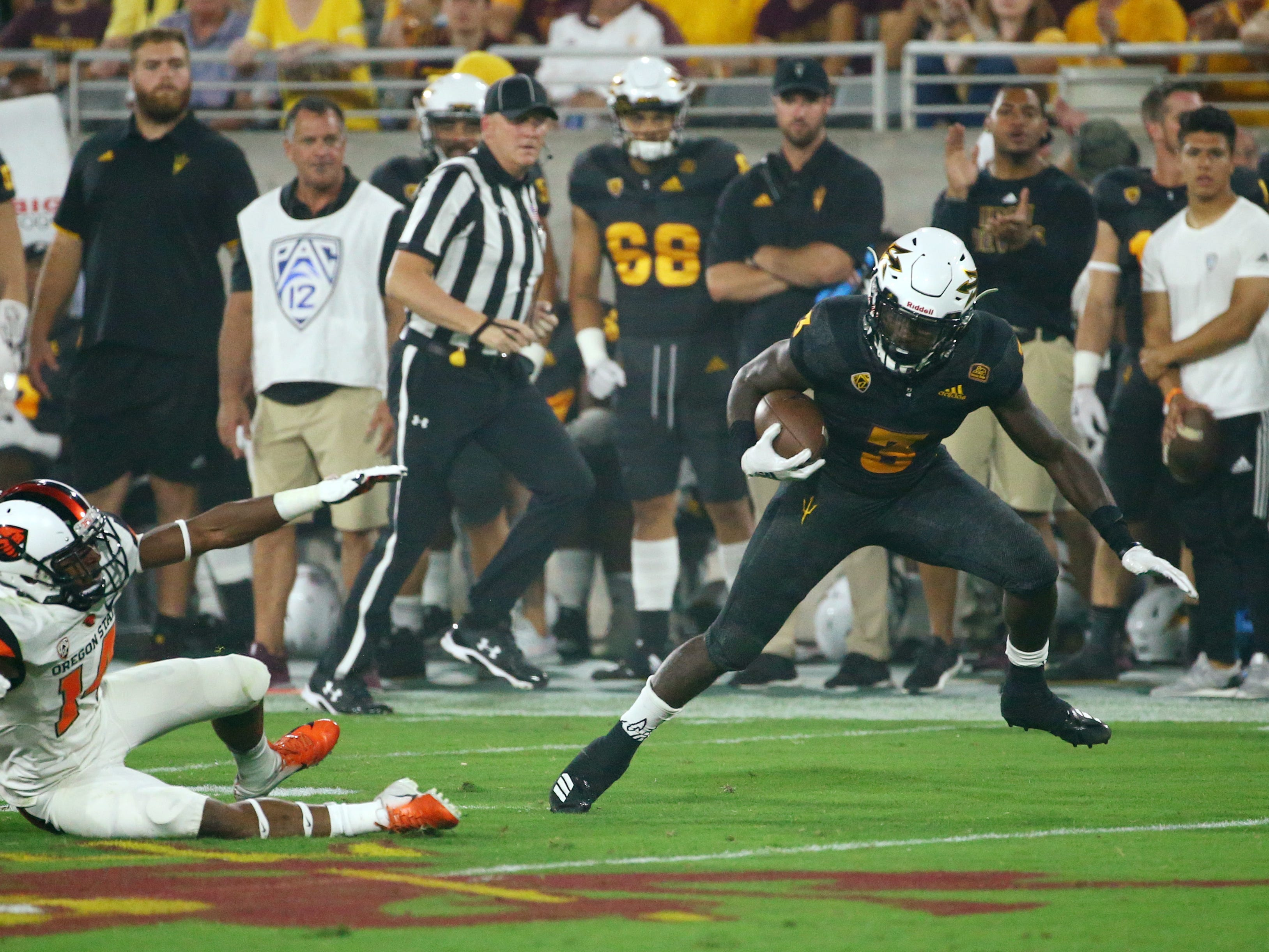 Arizona State running back Eno Benjamin breaks three tackles and runs for a touchdown against Oregon State in the first half on Sep. 29, 2018, at Sun Devil Stadium.
