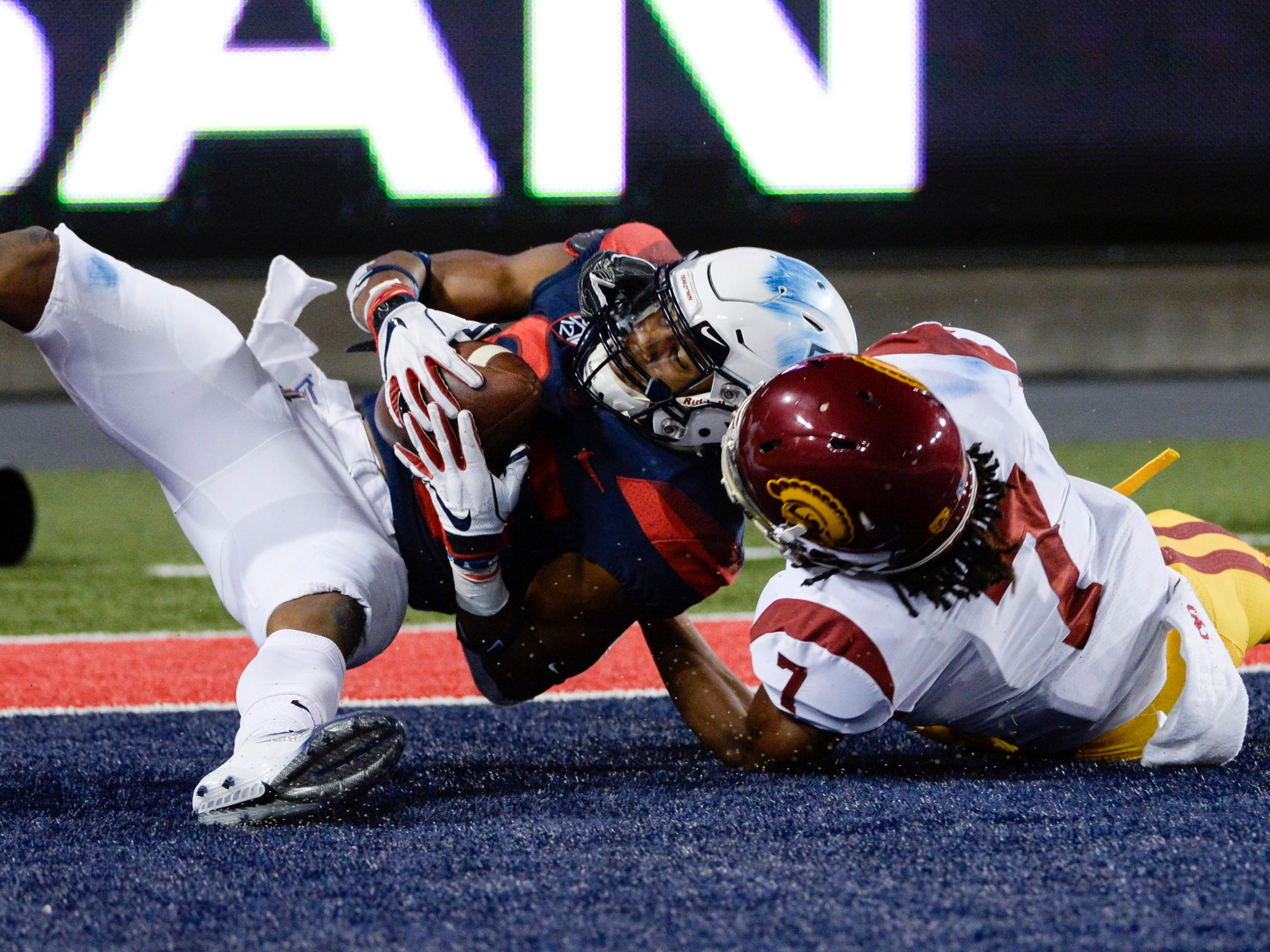 Sep 29, 2018; Tucson, AZ, USA; Arizona Wildcats wide receiver Stanley Berryhill III (86) scores a touchdown as Southern California Trojans safety Marvell Tell III (7) defends during the second half at Arizona Stadium. Mandatory Credit: Casey Sapio-USA TODAY Sports