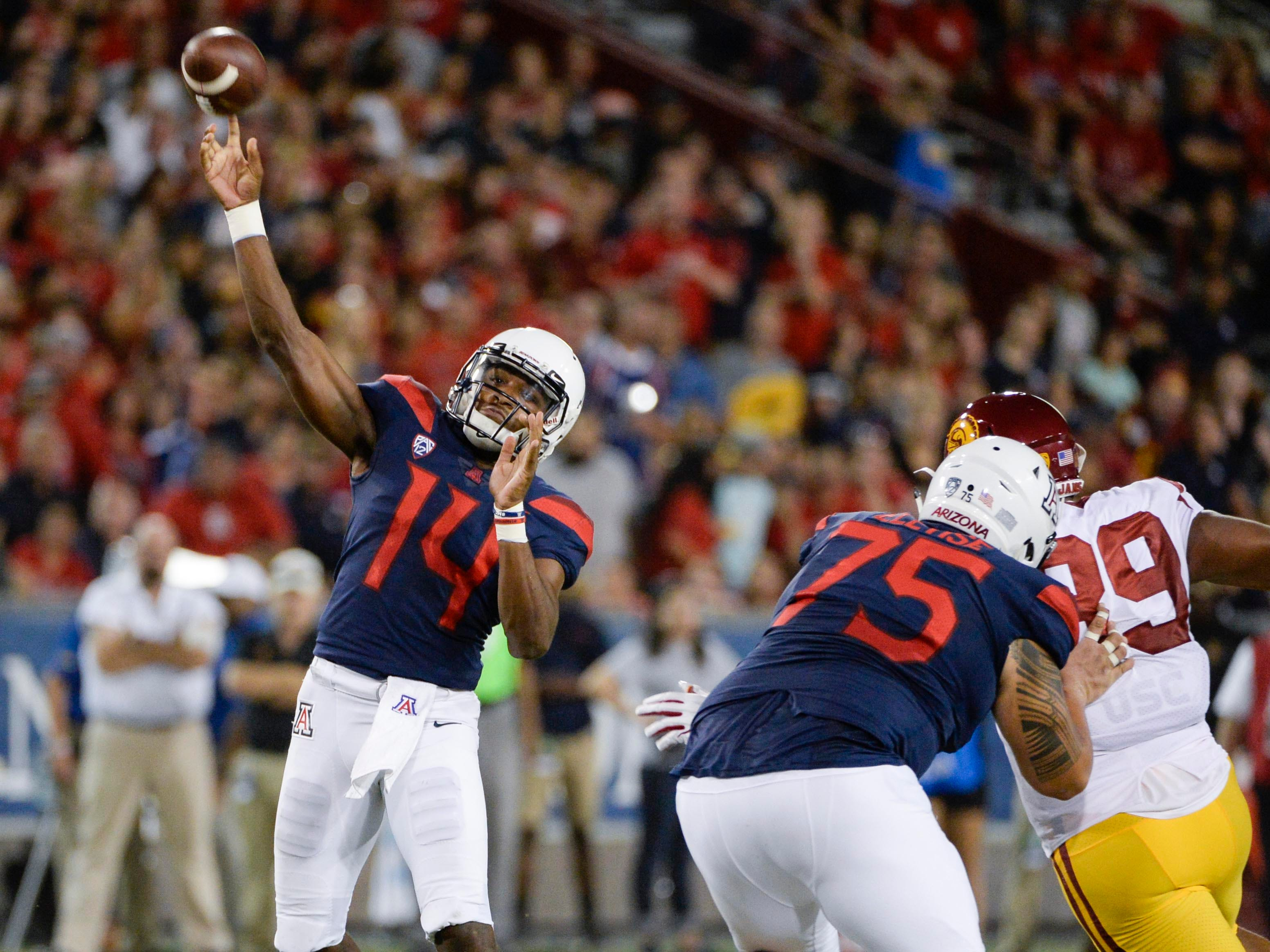 Sep 29, 2018; Tucson, AZ, USA; Arizona Wildcats quarterback Khalil Tate (14) passes the ball against the Southern California Trojans during the second half at Arizona Stadium. Mandatory Credit: Casey Sapio-USA TODAY Sports