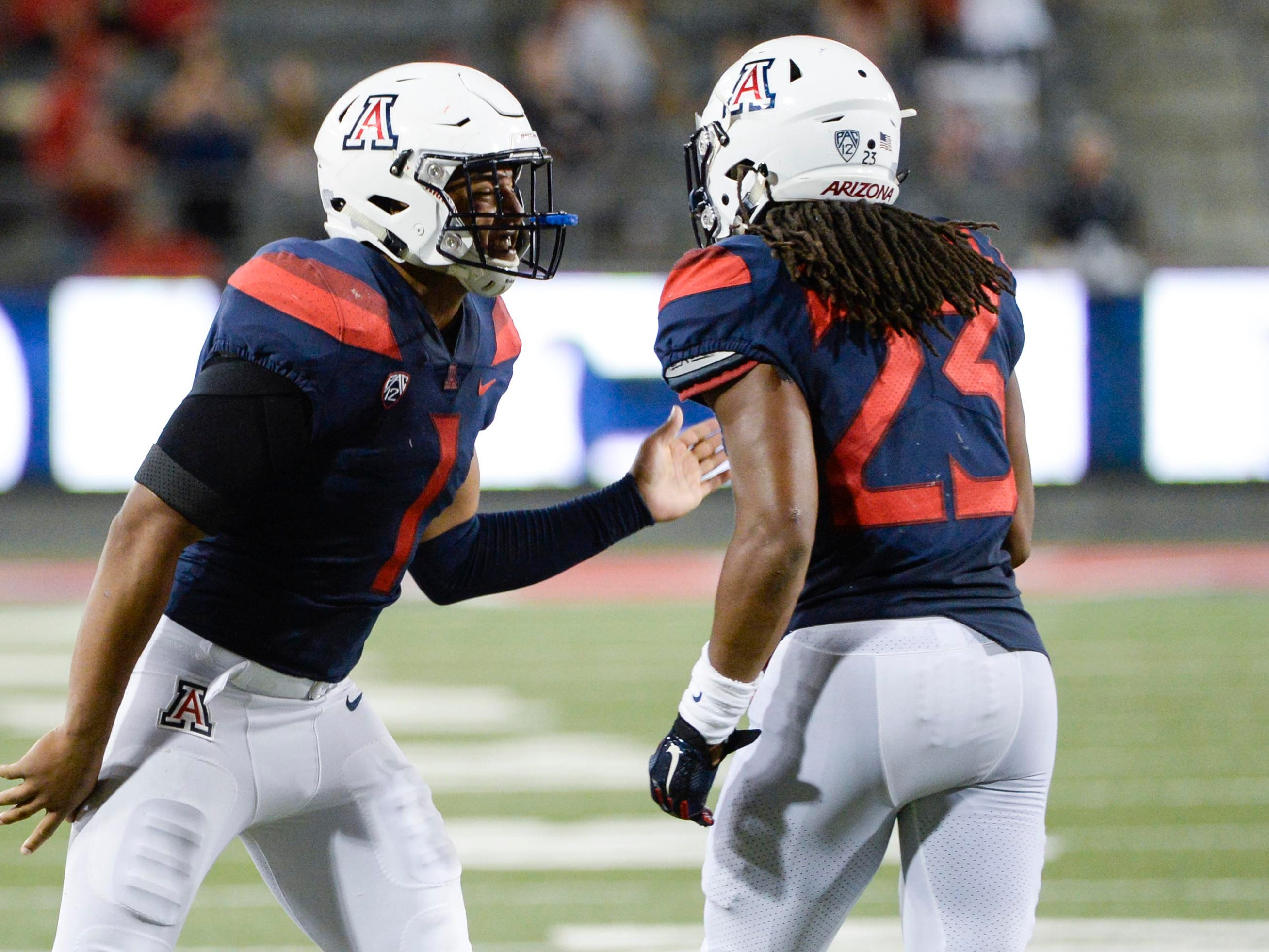 Sep 29, 2018; Tucson, AZ, USA; Arizona Wildcats linebacker Tony Fields II (1) and running back Gary Brightwell (23) (right) celebrate after a touchdown against the Southern California Trojans during the second half at Arizona Stadium. Mandatory Credit: Casey Sapio-USA TODAY Sports