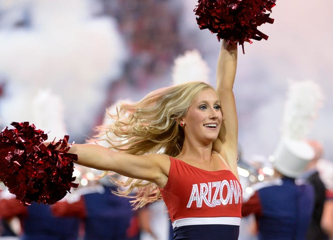 Sep 29, 2018; Tucson, AZ, USA; An Arizona Wildcats cheerleader performs before the game against the Southern California Trojans at Arizona Stadium. Mandatory Credit: Casey Sapio-USA TODAY Sports