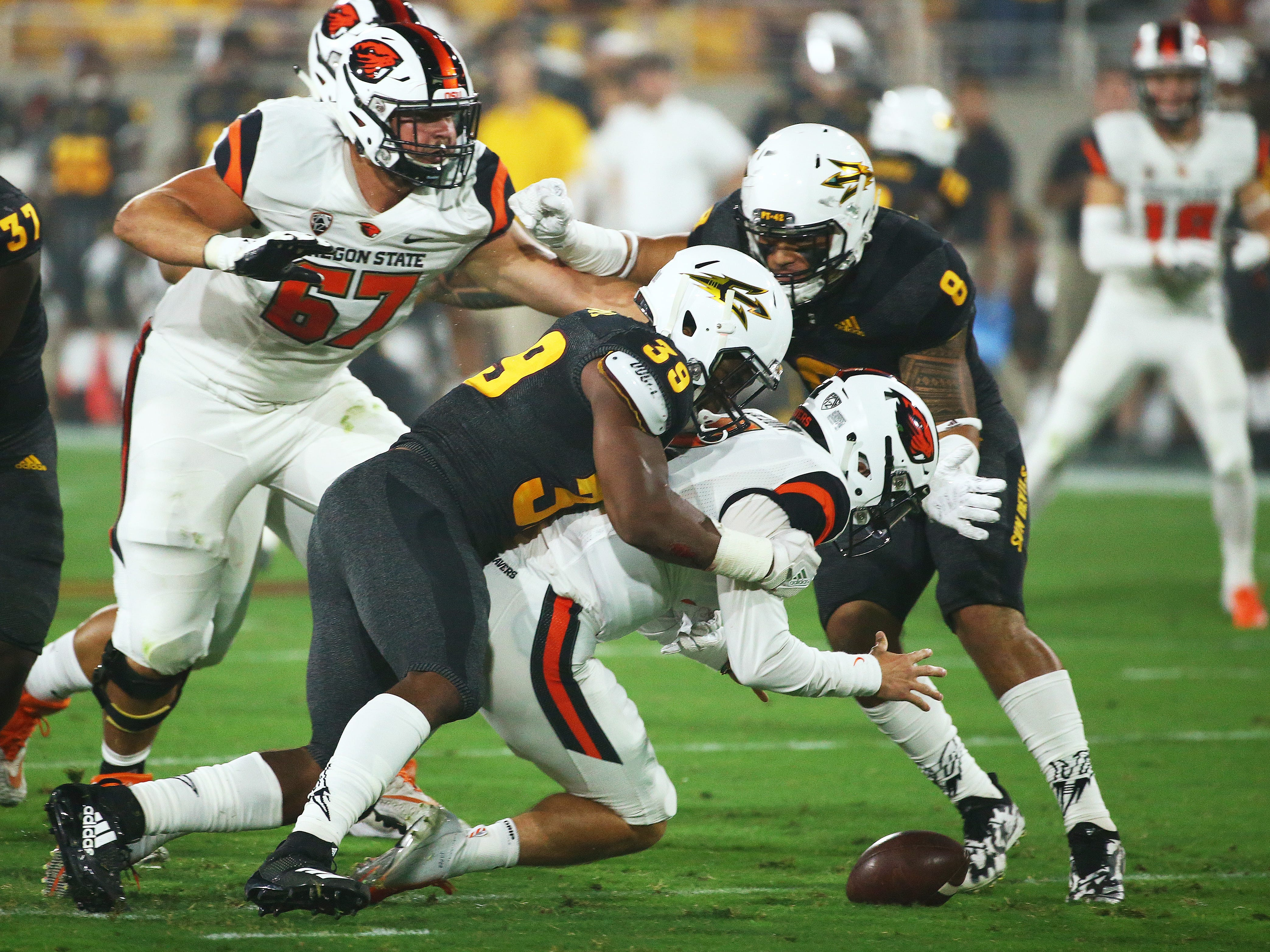 Arizona State linebacker Malik Lawal forces a fumble by Oregon State quarterback Conor Blount in the first half on Sep. 29, 2018, at Sun Devil Stadium. Oregon State recovered the ball.