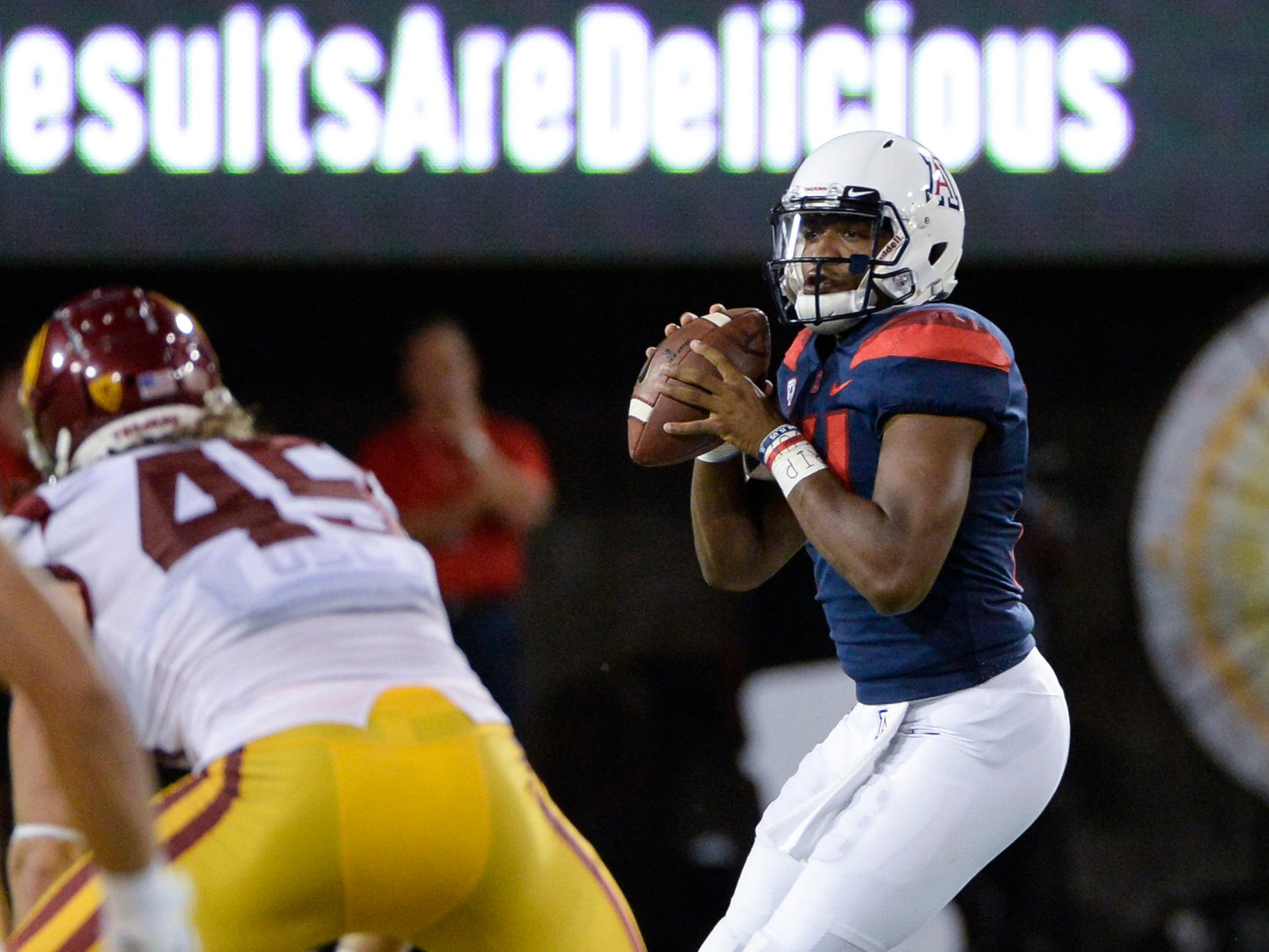 Sep 29, 2018; Tucson, AZ, USA; Arizona Wildcats quarterback Khalil Tate (14) looks to pass the ball against the Southern California Trojans at Arizona Stadium. Mandatory Credit: Casey Sapio-USA TODAY Sports