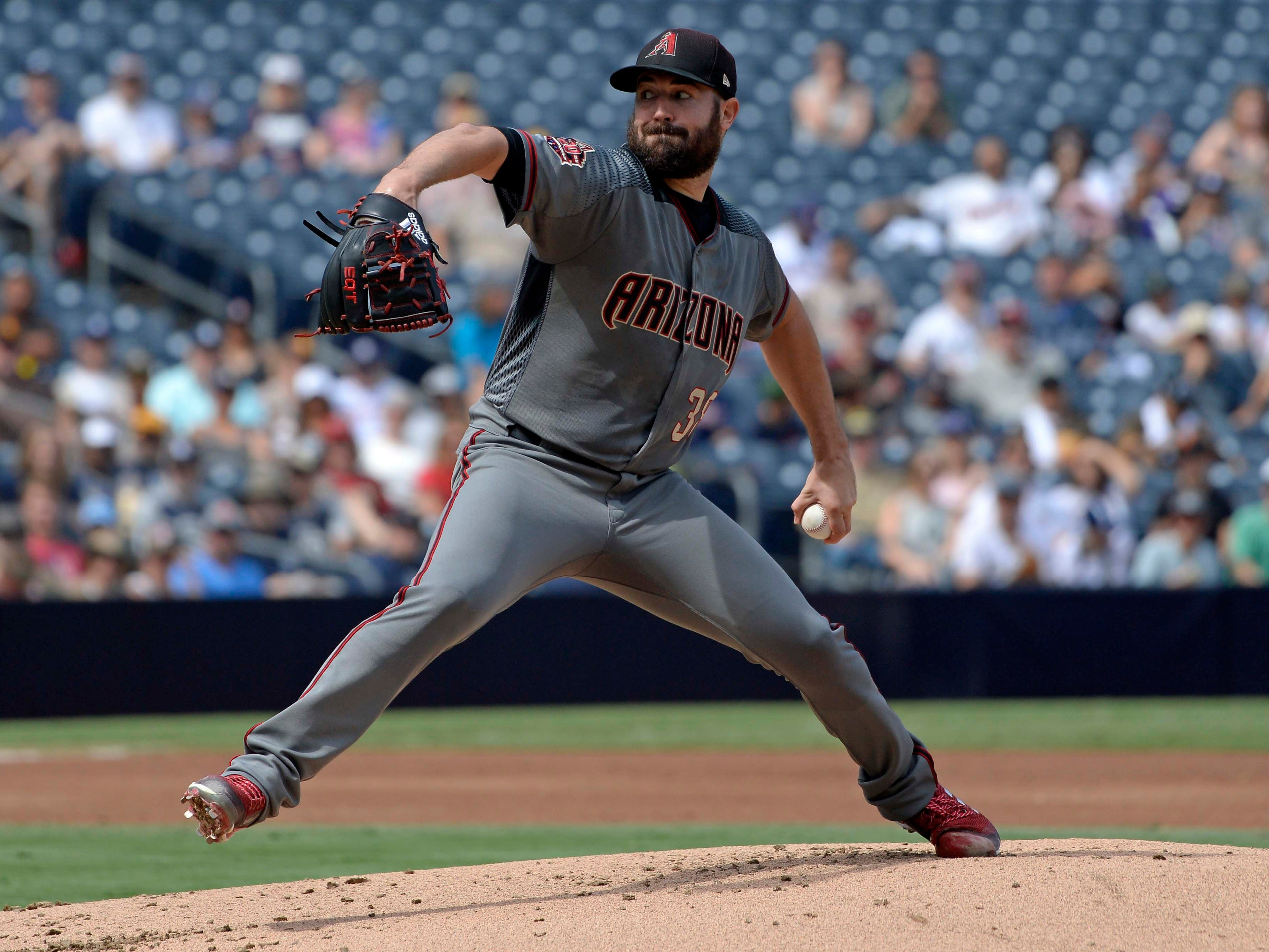 Sep 30, 2018; San Diego, CA, USA; Arizona Diamondbacks starting pitcher Robbie Ray (38) pitches against the San Diego Padres during the first inning at Petco Park. Mandatory Credit: Jake Roth-USA TODAY Sports