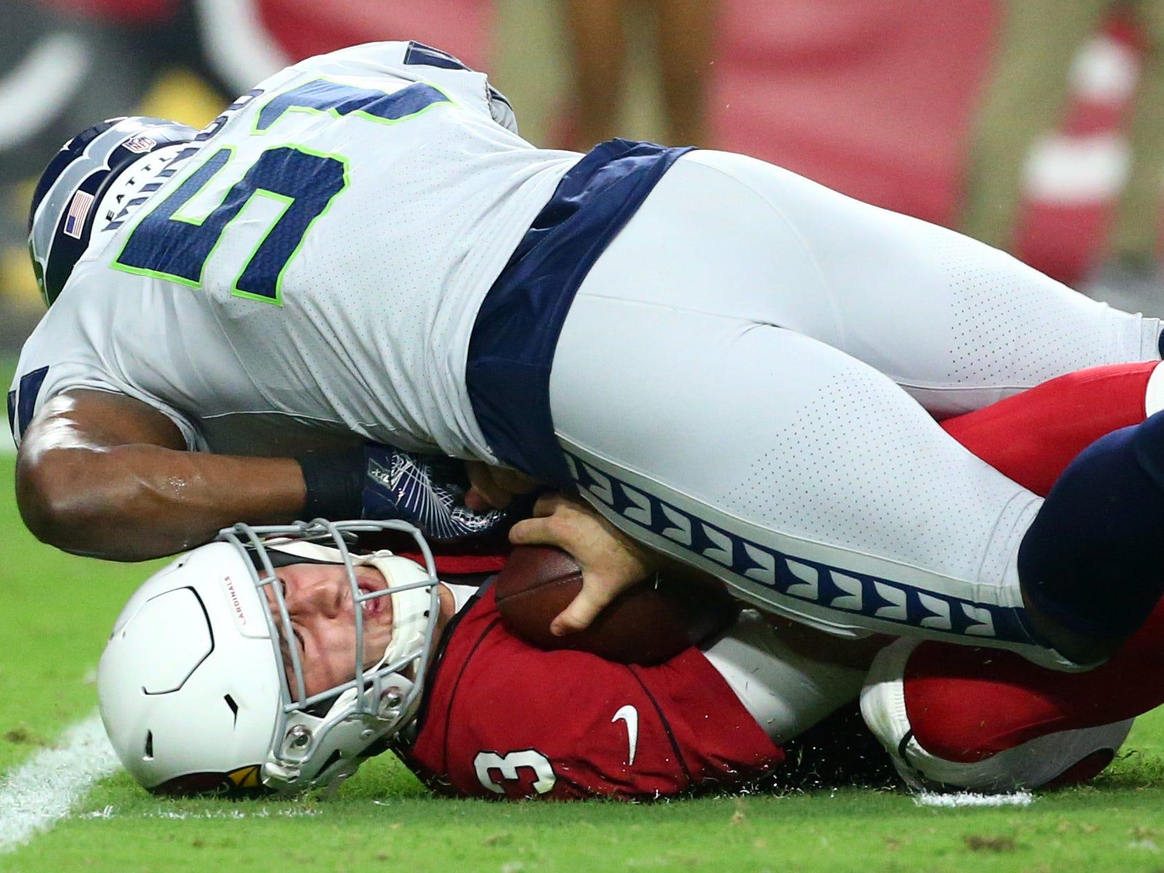 Arizona Cardinals quarterback Josh Rosen is sacked by Seattle Seahawks linebacker Barkevious Mingo in the first half at State Farm Stadium in Glendale, Ariz.