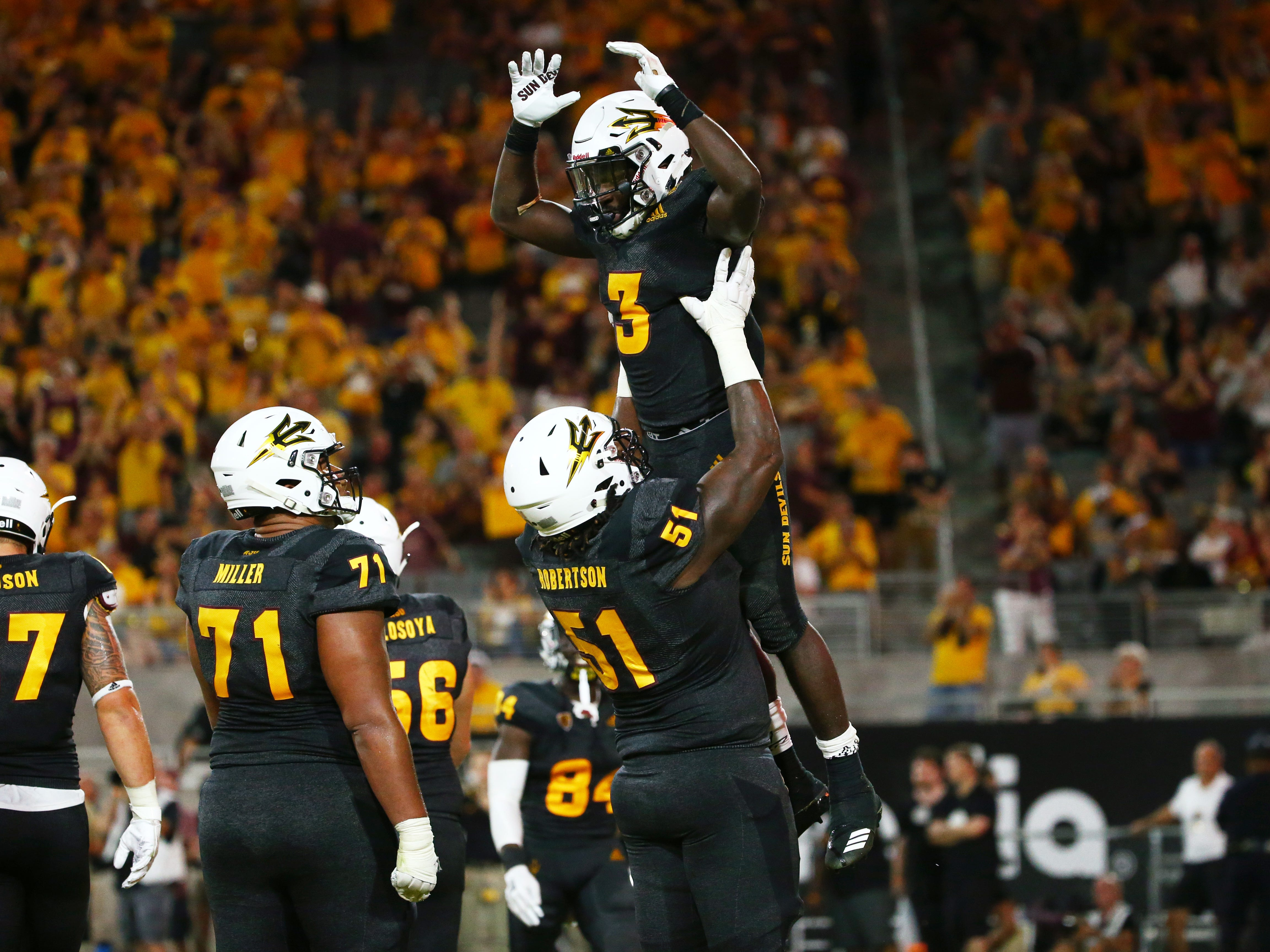 Arizona State running back Eno Benjamin celebrates his touchdown against Oregon State in the second half on Sep. 29, 2018, at Sun Devil Stadium.