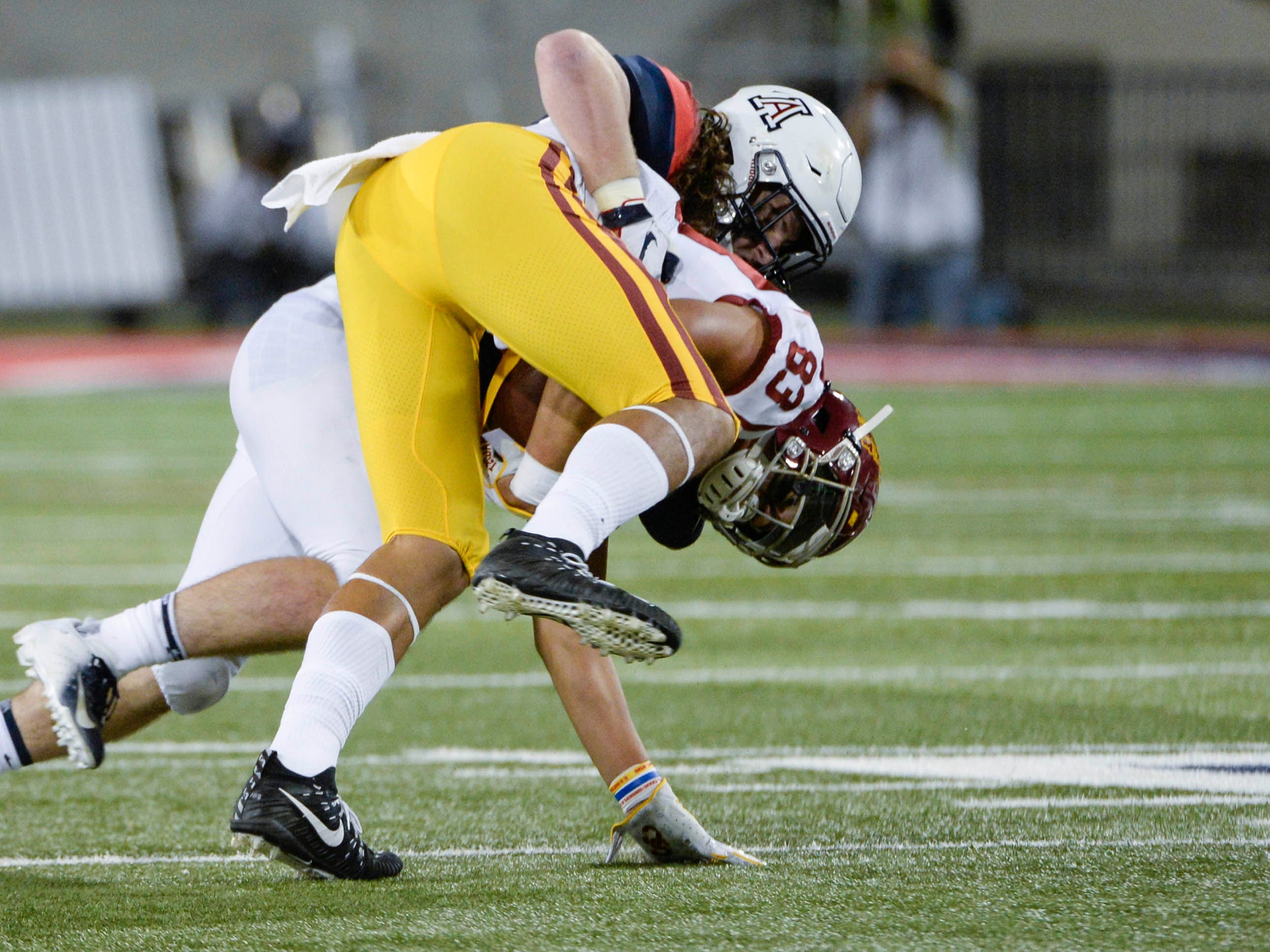 Sep 29, 2018; Tucson, AZ, USA; Southern California Trojans tight end Josh Falo (83) fumbles the ball as he is tackled by Arizona Wildcats linebacker Colin Schooler (7) during the second half at Arizona Stadium. Mandatory Credit: Casey Sapio-USA TODAY Sports
