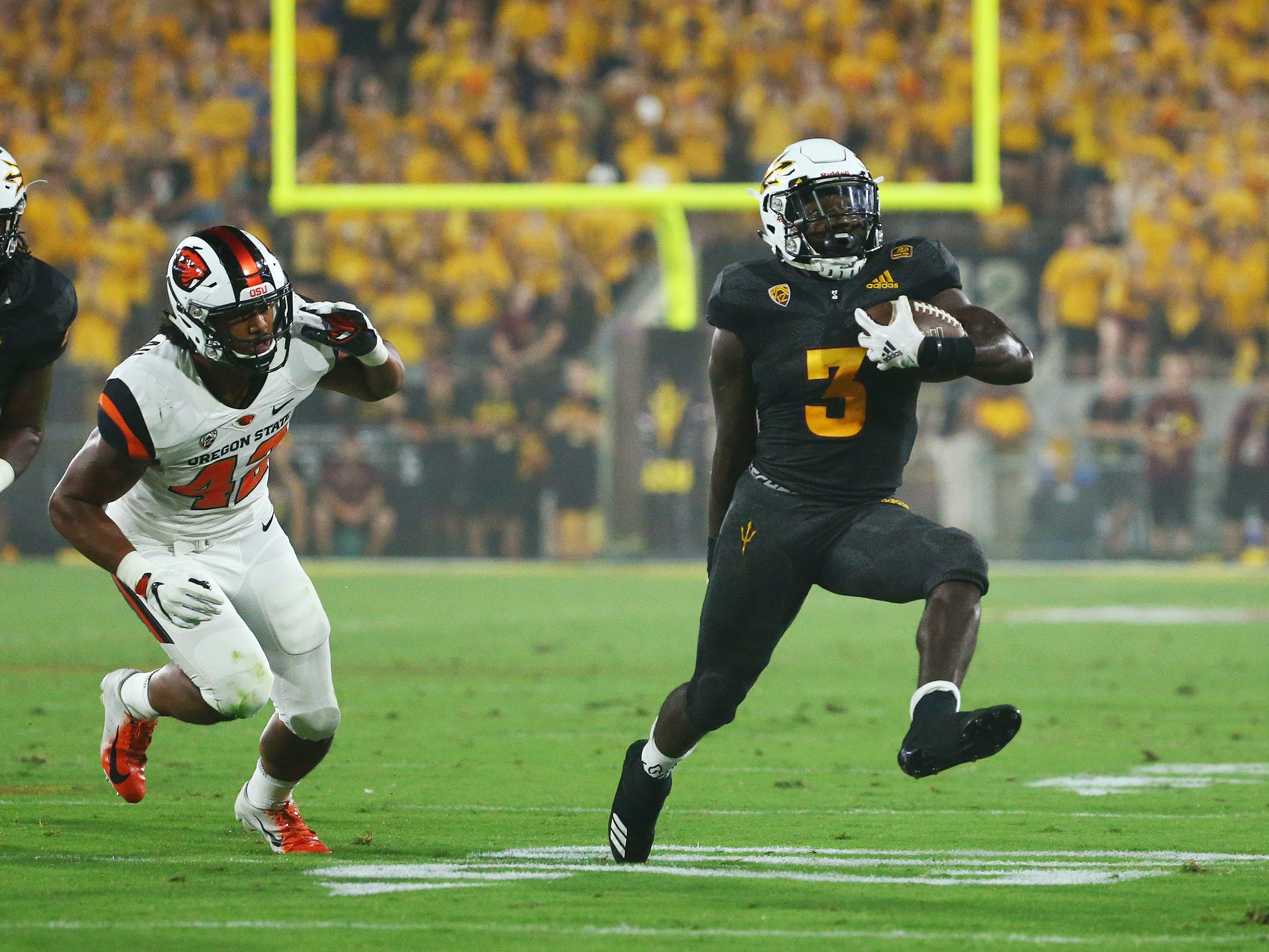 Arizona State running back Eno Benjamin runs for a first down against Oregon State in the first half on Sep. 29, 2018, at Sun Devil Stadium.