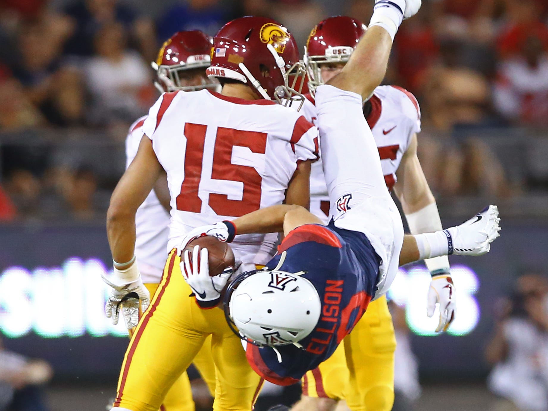 Sep 29, 2018; Tucson, AZ, USA; Arizona Wildcats wide receiver Tony Ellison (9) is upended by Southern California Trojans safety Talanoa Hufanga (15) in the first half at Arizona Stadium. Mandatory Credit: Mark J. Rebilas-USA TODAY Sports