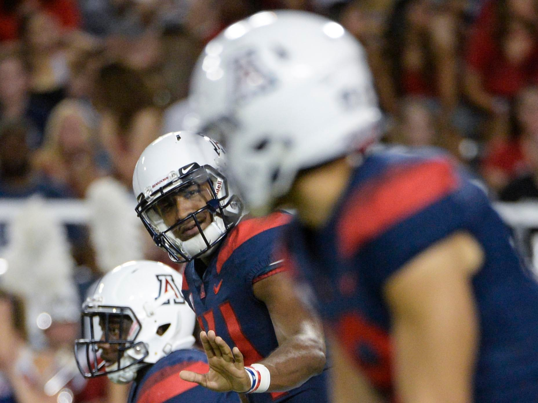 Sep 29, 2018; Tucson, AZ, USA; Arizona Wildcats quarterback Khalil Tate (14) signals during the first half against the Southern California Trojans at Arizona Stadium. Mandatory Credit: Casey Sapio-USA TODAY Sports