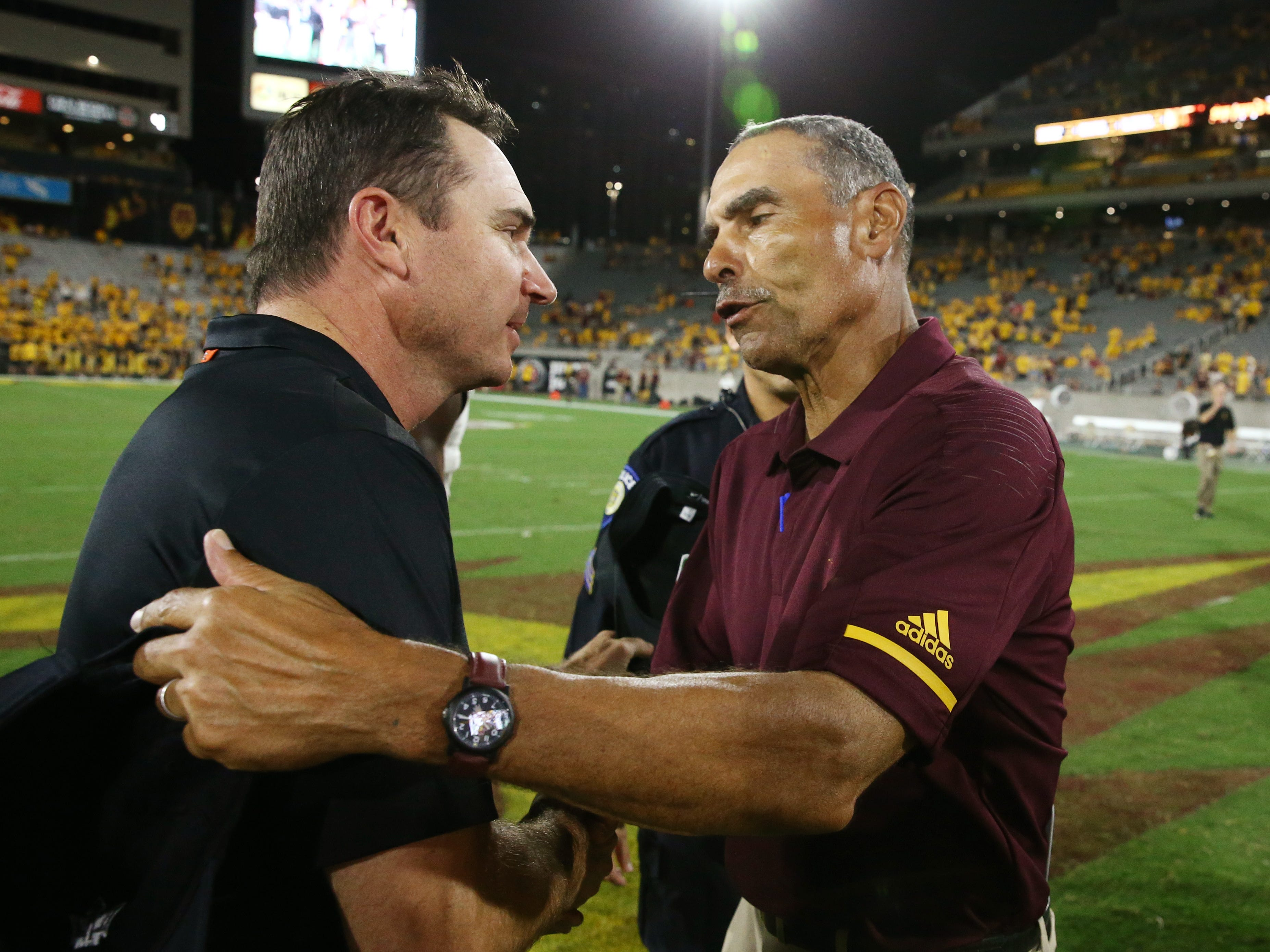 Arizona State head coach Herm Edwards greets Oregon State head coach Jonathan Smith after the Sun Devils defeated the Beavers 52-24 on Sep. 29, 2018, at Sun Devil Stadium.