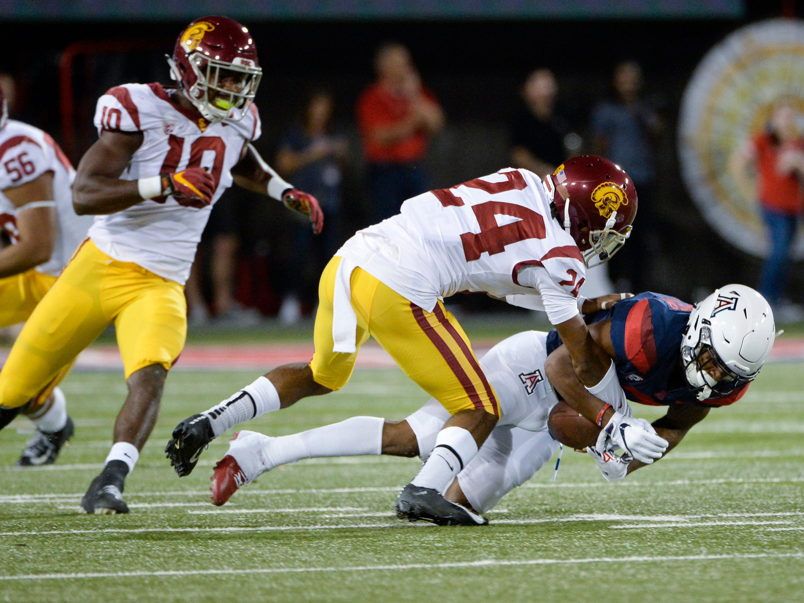 Sep 29, 2018; Tucson, AZ, USA; Arizona Wildcats wide receiver Devaughn Cooper (7) is tackled by Southern California Trojans cornerback Isaiah Langley (24) at Arizona Stadium. Mandatory Credit: Casey Sapio-USA TODAY Sports