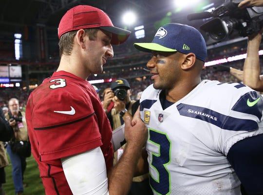 Arizona Cardinals quarterback Josh Rosen and Seattle Seahawks quarterback Russell Wilson meet after Seattle defeated Arizona 20-17 at State Farm Stadium last season.