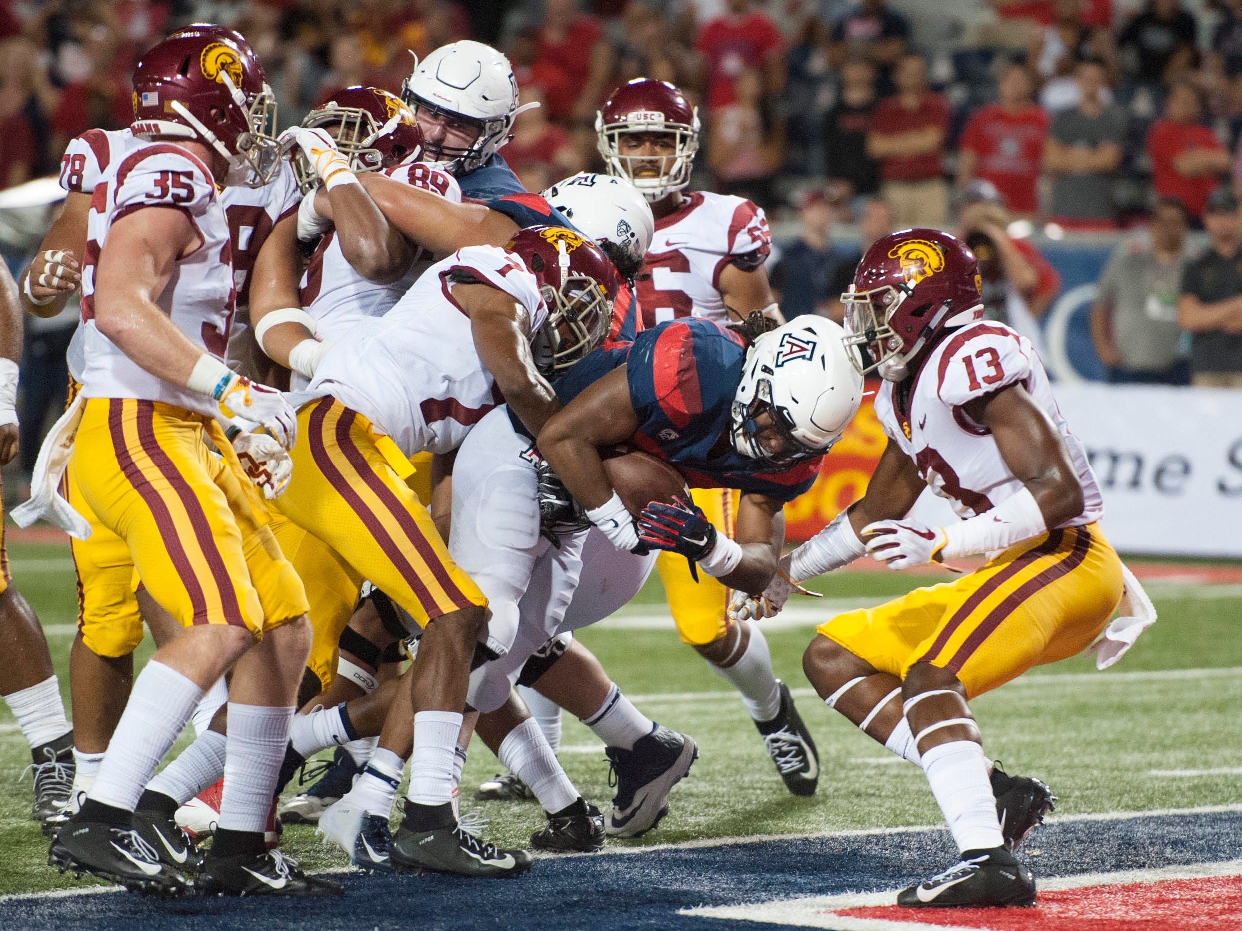 Sep 29, 2018; Tucson, AZ, USA; Arizona Wildcats running back Gary Brightwell (23) scores a touchdown against the Southern California Trojans during the second half at Arizona Stadium. Mandatory Credit: Casey Sapio-USA TODAY Sports