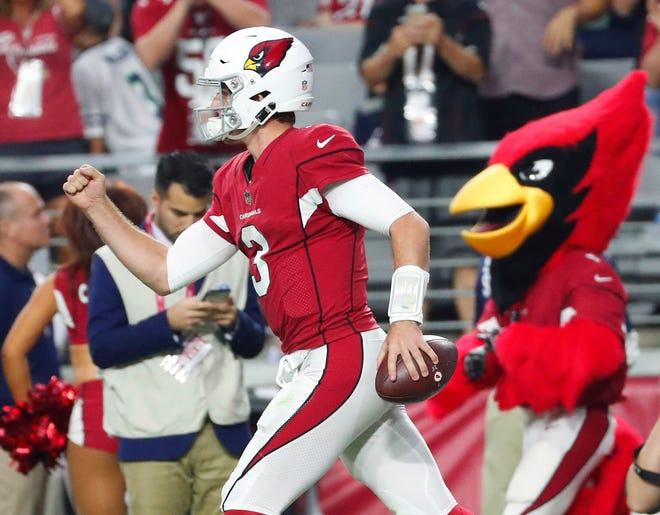 Arizona Cardinals quarterback Josh Rosen (3) celebrates his first career touchdown pass during the fourth quarter against the Seattle Seahawks at State Farm Stadium in Glendale, Ariz. September 30, 2018.