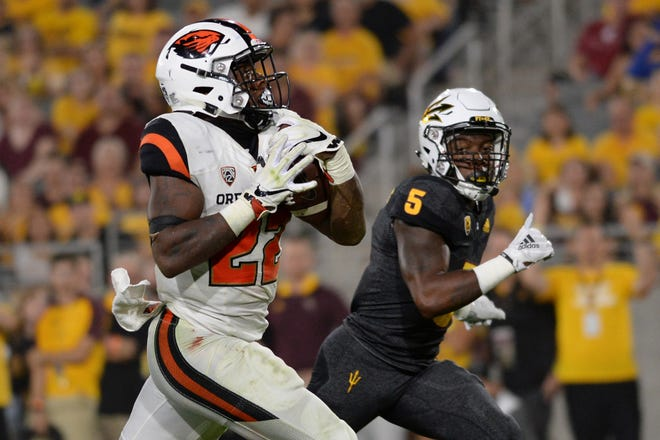 Sep 29, 2018: Oregon State Beavers running back Jermar Jefferson (22) runs for a touchdown against the Arizona State Sun Devils during the first half at Sun Devil Stadium.