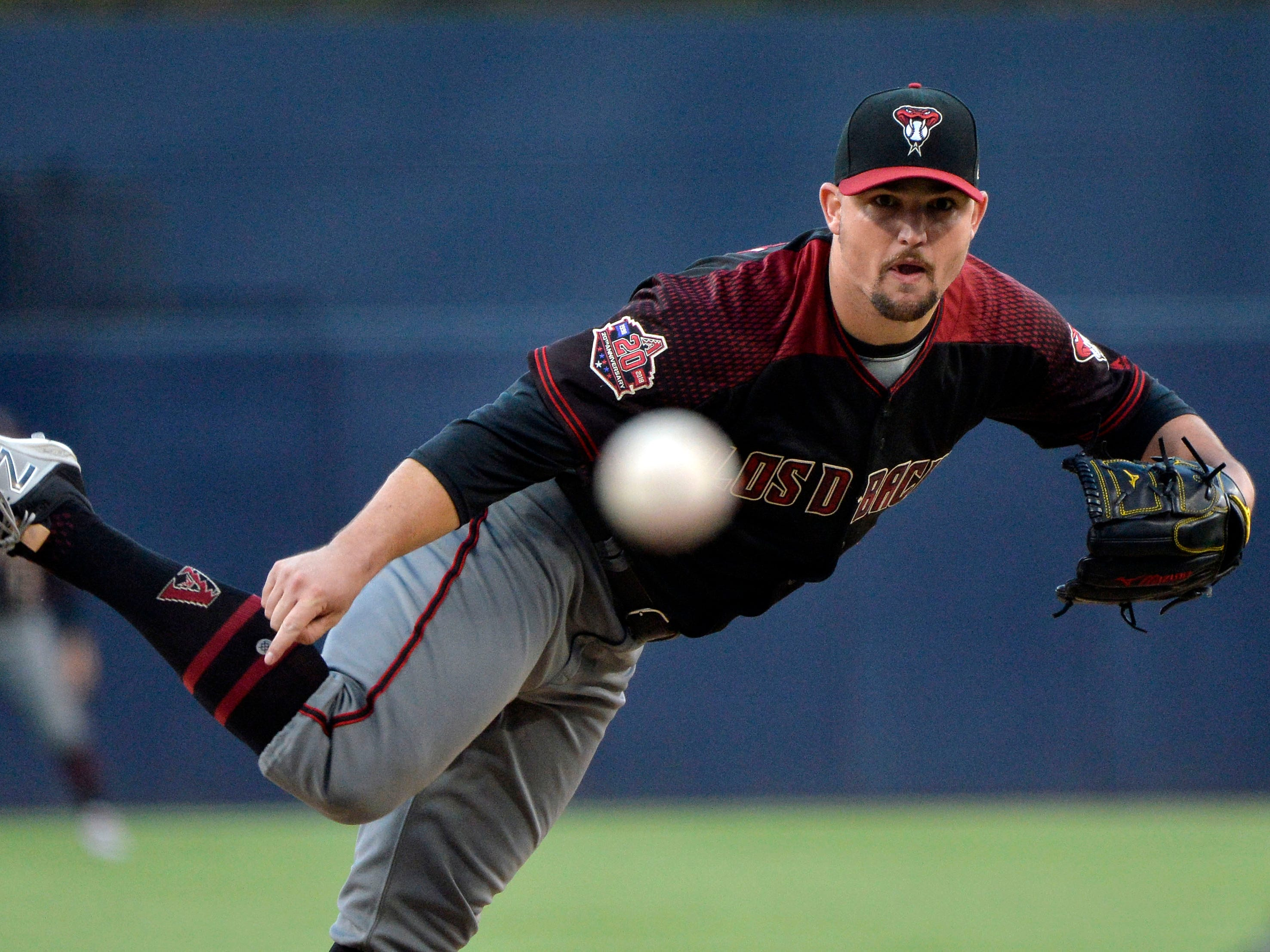 Sep 29, 2018; San Diego, CA, USA; Arizona Diamondbacks starting pitcher Zack Godley (52) pitches during the first inning against the San Diego Padres at Petco Park. Mandatory Credit: Jake Roth-USA TODAY Sports