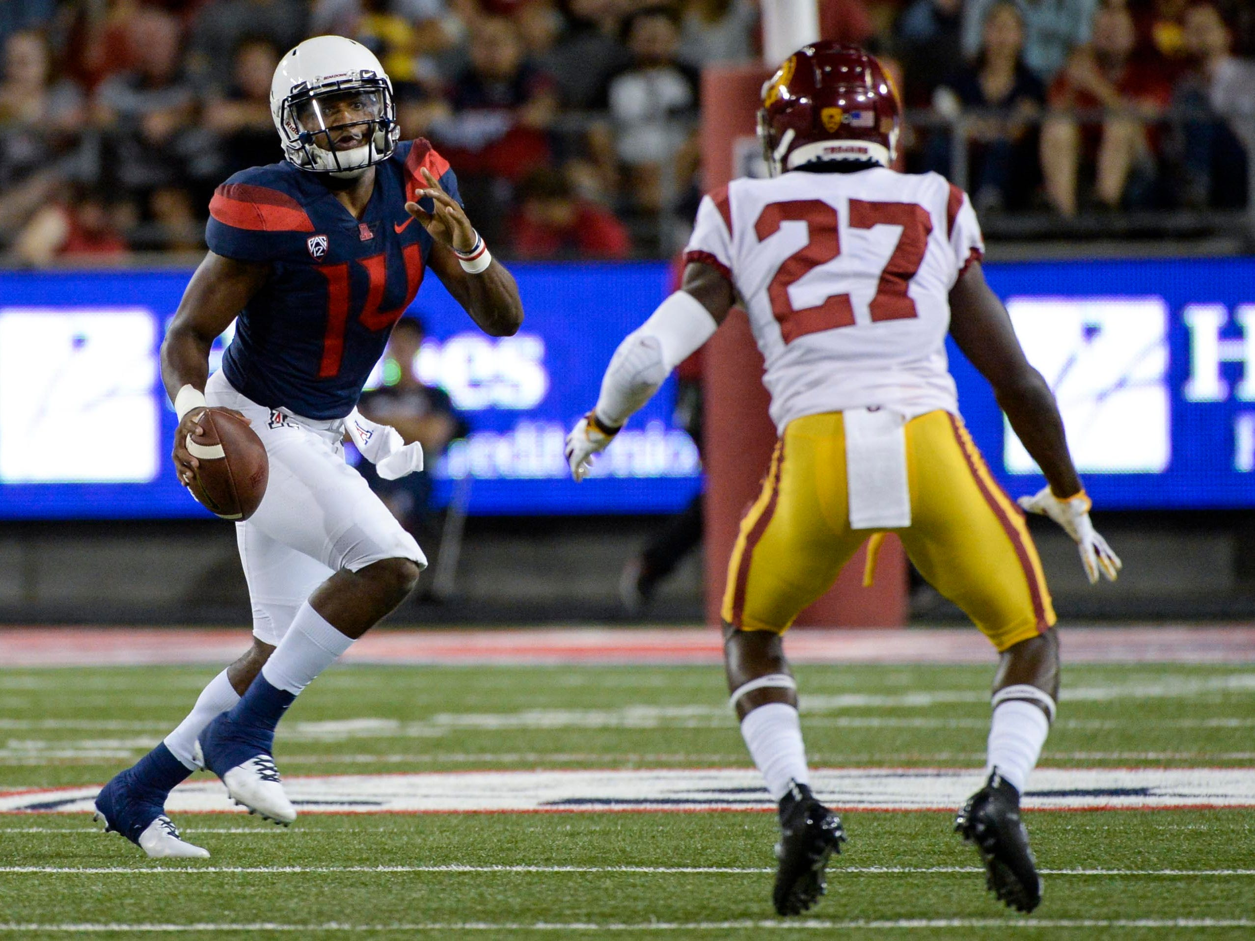 Sep 29, 2018; Tucson, AZ, USA; Arizona Wildcats quarterback Khalil Tate (14) looks to pass as Southern California Trojans cornerback Ajene Harris (27) defends during the first half at Arizona Stadium. Mandatory Credit: Casey Sapio-USA TODAY Sports