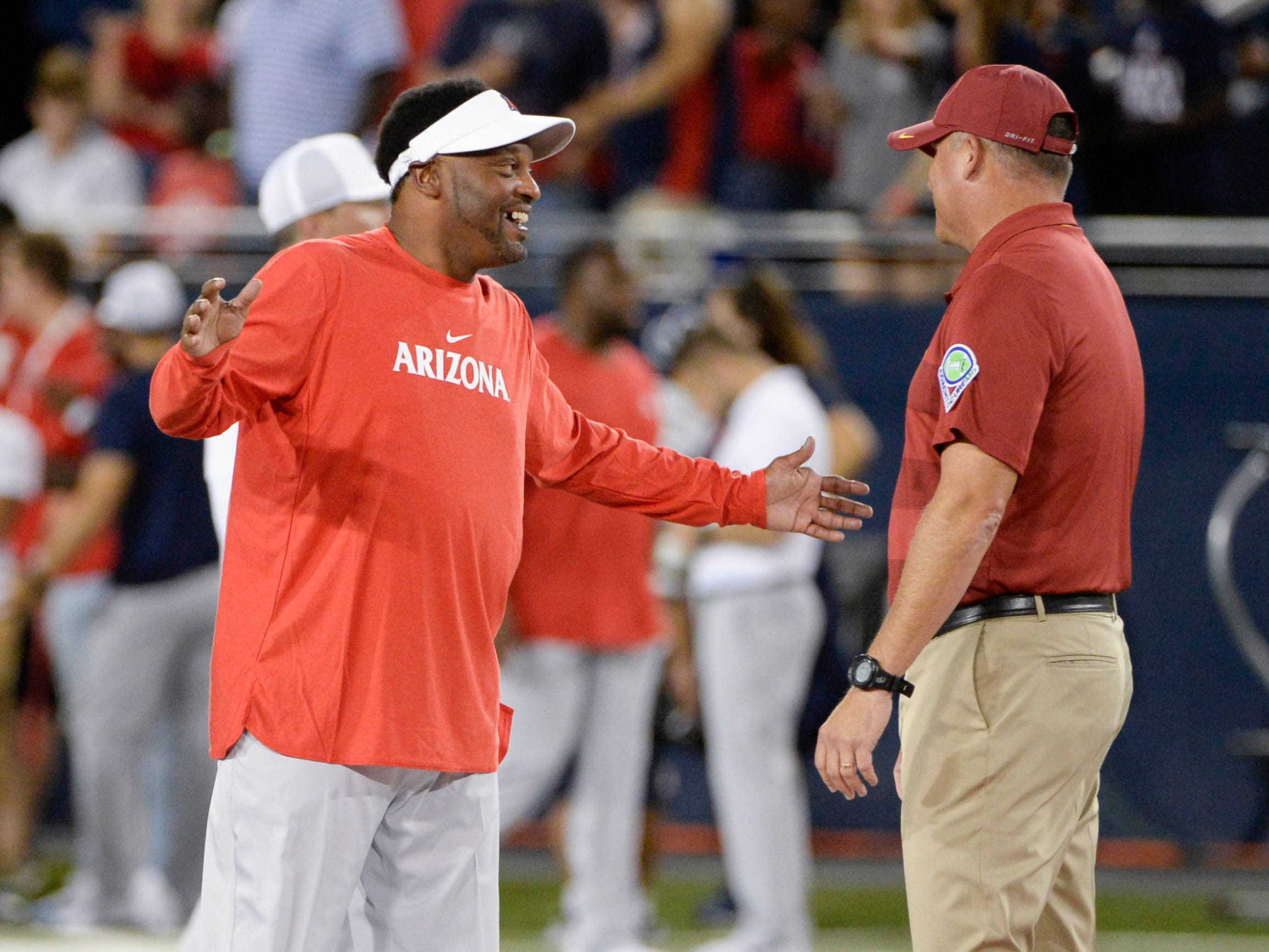 Sep 29, 2018; Tucson, AZ, USA; Arizona Wildcats head coach Kevin Sumlin and Southern California Trojans head coach Clay Helton (left) talk before the game at Arizona Stadium. Mandatory Credit: Casey Sapio-USA TODAY Sports