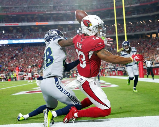 Arizona Cardinals wide receiver Christian Kirk (13) draws a pass interference call from Seattle Seahawks cornerback Justin Coleman (28) during the second quarter at State Farm Stadium in Glendale, Ariz. September 30, 2018.