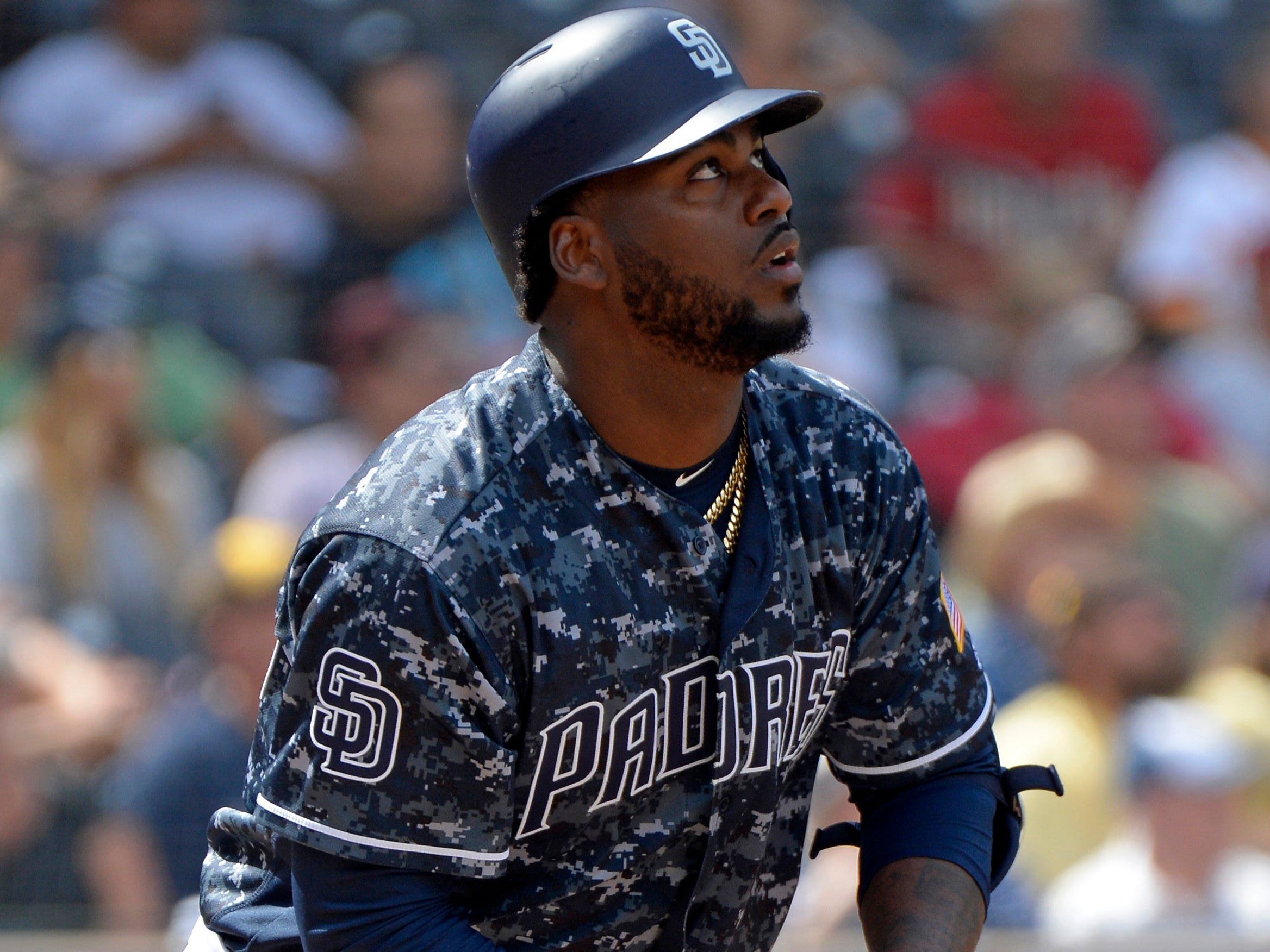 Sep 30, 2018; San Diego, CA, USA; San Diego Padres right fielder Franmil Reyes (32) watches his RBI double in the fifth inning against the Arizona Diamondbacks at Petco Park. Mandatory Credit: Jake Roth-USA TODAY Sports