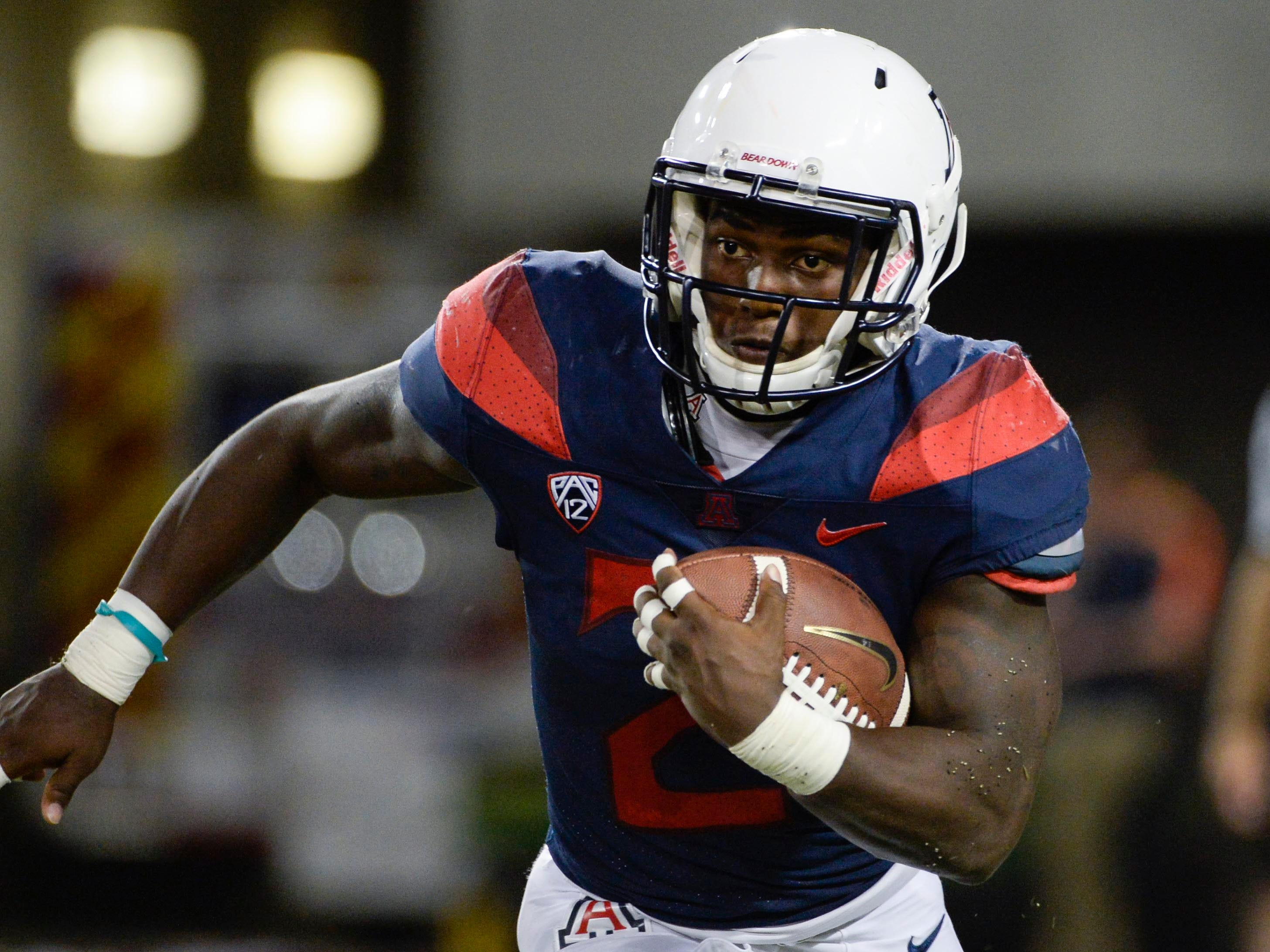 Sep 29, 2018; Tucson, AZ, USA; Arizona Wildcats running back J.J. Taylor (21) runs the ball against the Southern California Trojans during the second half at Arizona Stadium. Mandatory Credit: Casey Sapio-USA TODAY Sports