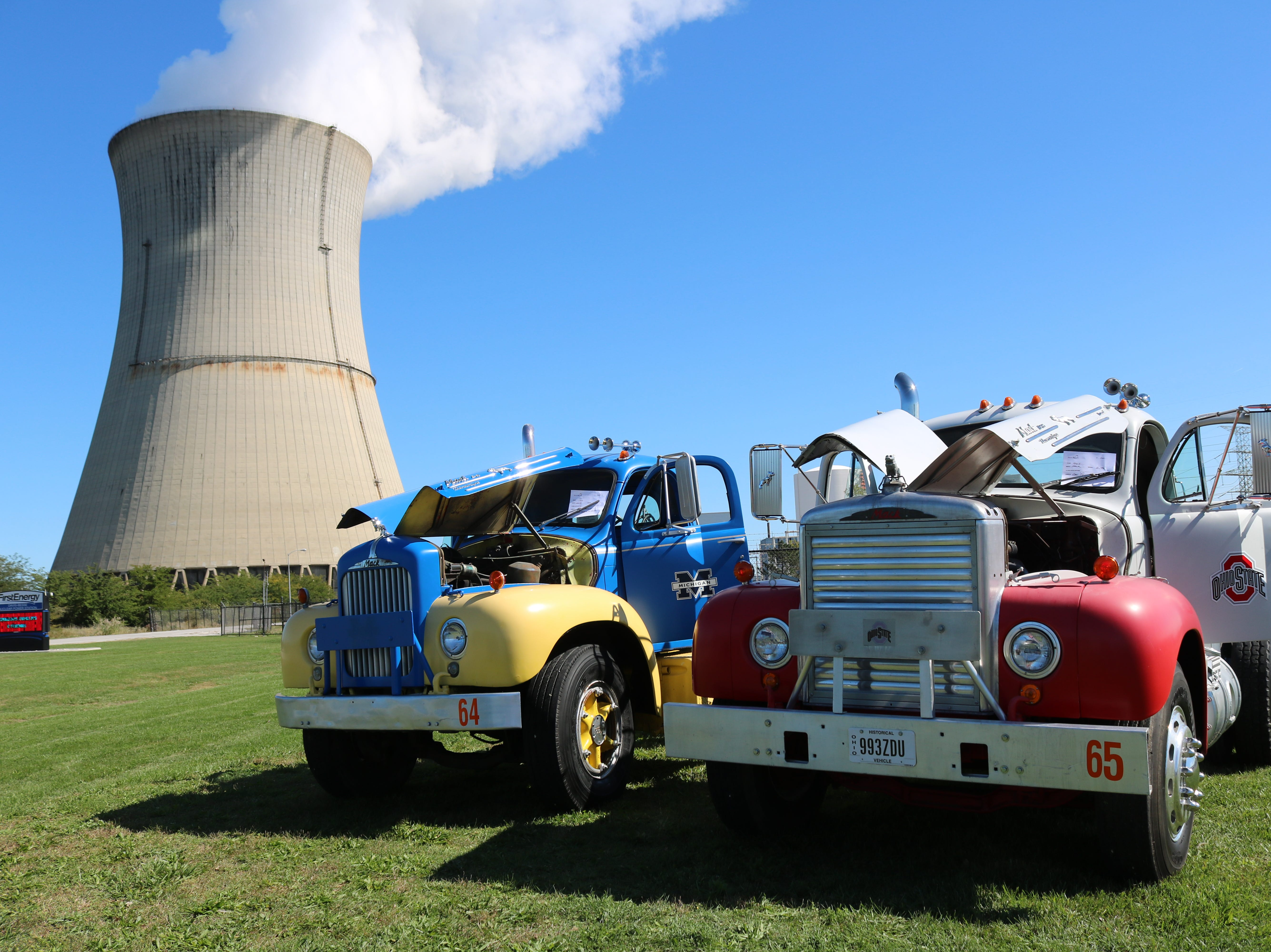 These two 1960s-era Mack trucks were painted as a pair of Ohio State and Michigan rivals at the Davis-Besse Cruisin' To The Future Car Show on Saturday.