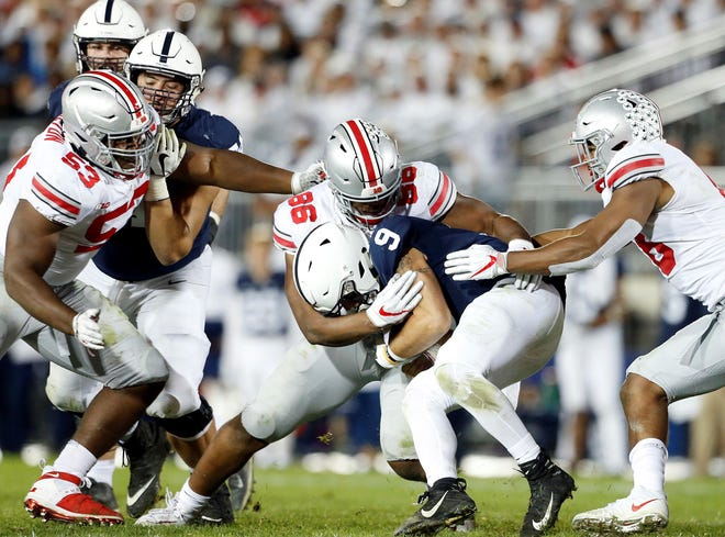 Penn State quarterback Trace McSorley (9) is sacked by Ohio State's Dre'Mont Jones (86) during the second half of an NCAA college football game in State College, Pa., Saturday, Sept. 29, 2018. Ohio State won 27-26. (AP Photo/Chris Knight)