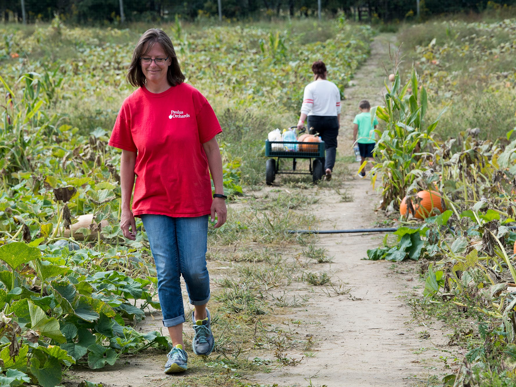 Karen Paulus, who owns Paulus Orchards with her husband, Dan, walks through the u-pick pumpkin field in Monaghan Township.