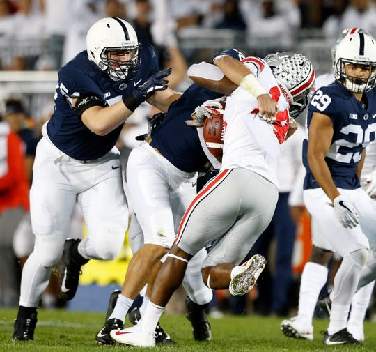 Ohio State's K.J. Hill (14) is hit immediately after a catch by Penn State's Jan Johnson (36) during the first half of an NCAA college football game in State College, Pa., Saturday, Sept. 29, 2018. (AP Photo/Chris Knight)