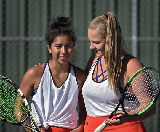 Reno's Jazlyn Parker, left, and Sage Schula are one of Reno high's top double tennis teams.