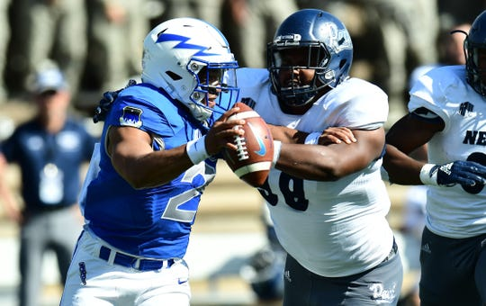 Nevada's Korey Rush (99) sacks Air Force quarterback Arion Worthman during the second quarter at Falcon Stadium.