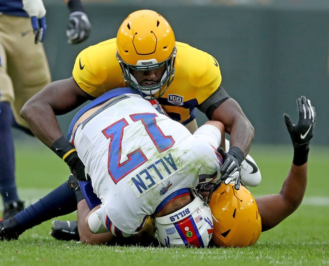 Green Bay Packers linebacker Reggie Gilbert and linebacker Oren Burks sack Buffalo Bills quarterback Josh Allen.