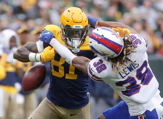 Green Bay Packers' Geronimo Allison drops the ball as he is hit by Buffalo Bills' Ryan Lewis.