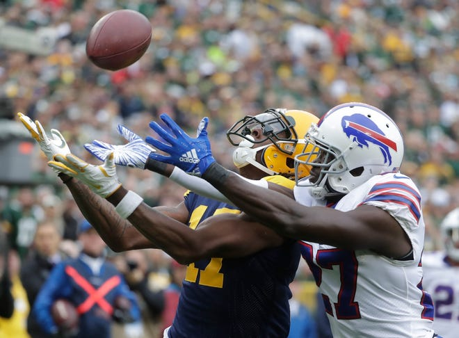 Buffalo Bills' Tre'Davious White breaks up a pass intended for Green Bay Packers' Davante Adams during the first half.
