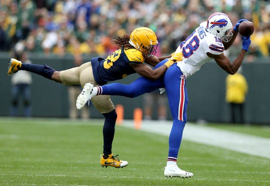Andre Holmes of the Buffalo Bills is unable to catch a pass in front of Tramon Williams of the Green Bay Packers during the second quarter.