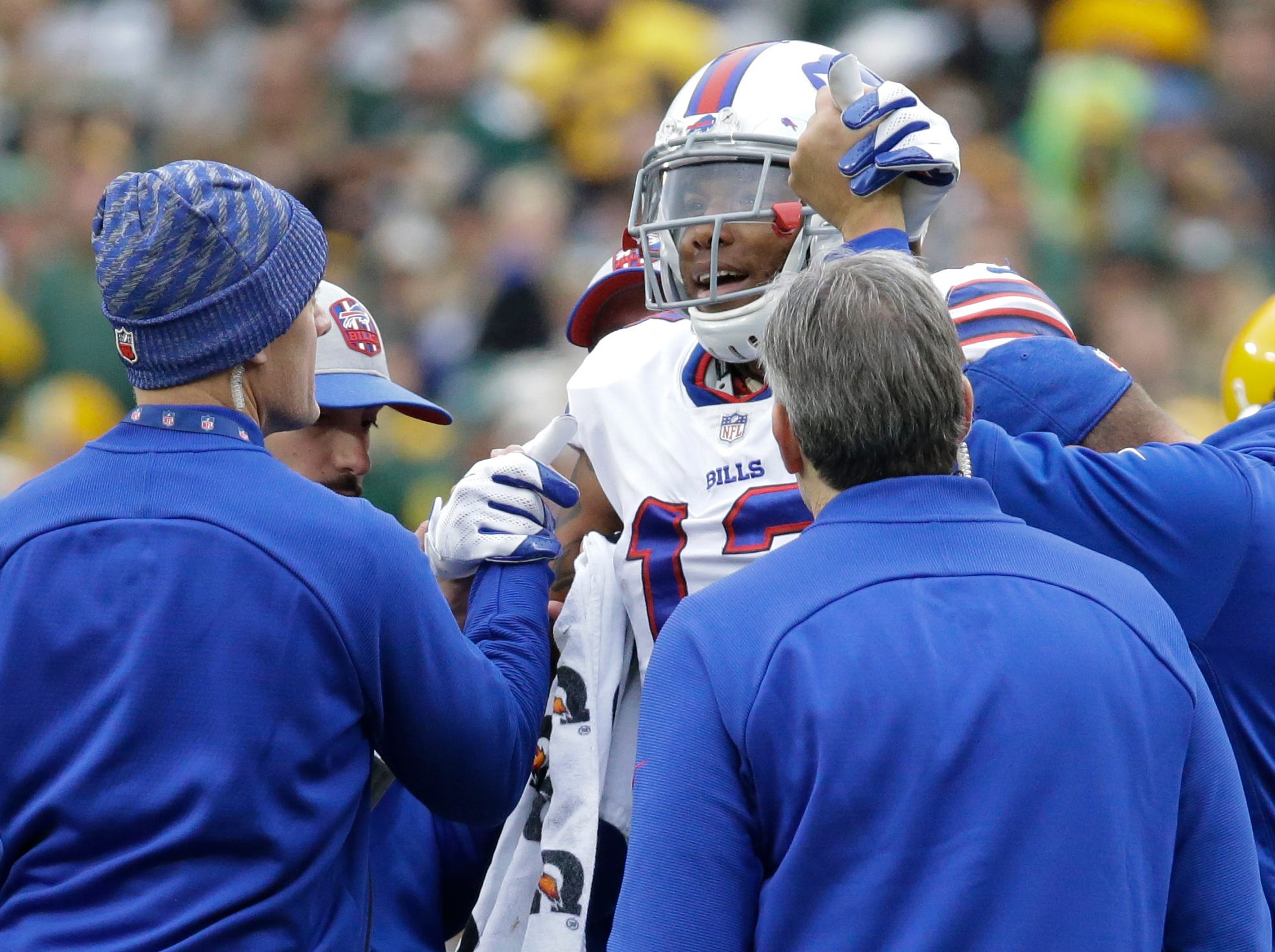 Buffalo Bills' Kelvin Benjamin is helped off the field after being injured during the second half of an NFL football game against the Green Bay Packers.